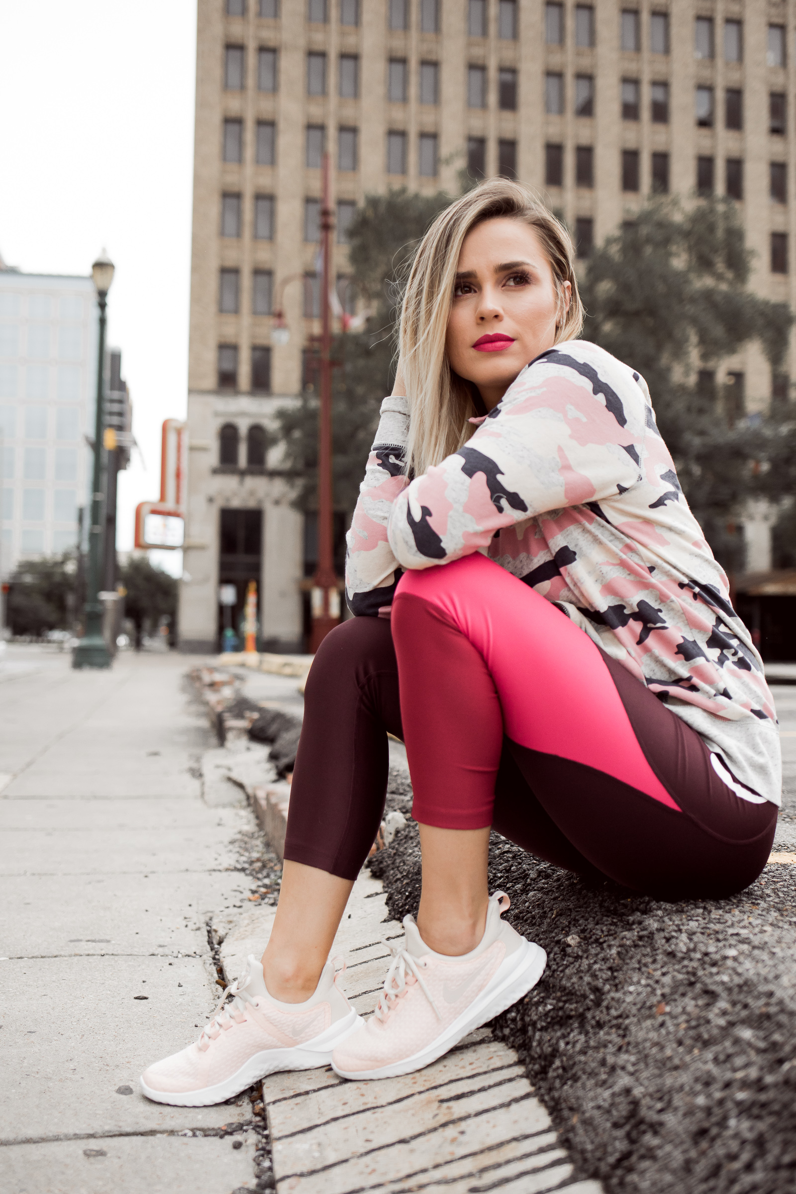Houston Fashion blogger Uptown with Elly Brown wears pink color-block Nike crop leggings