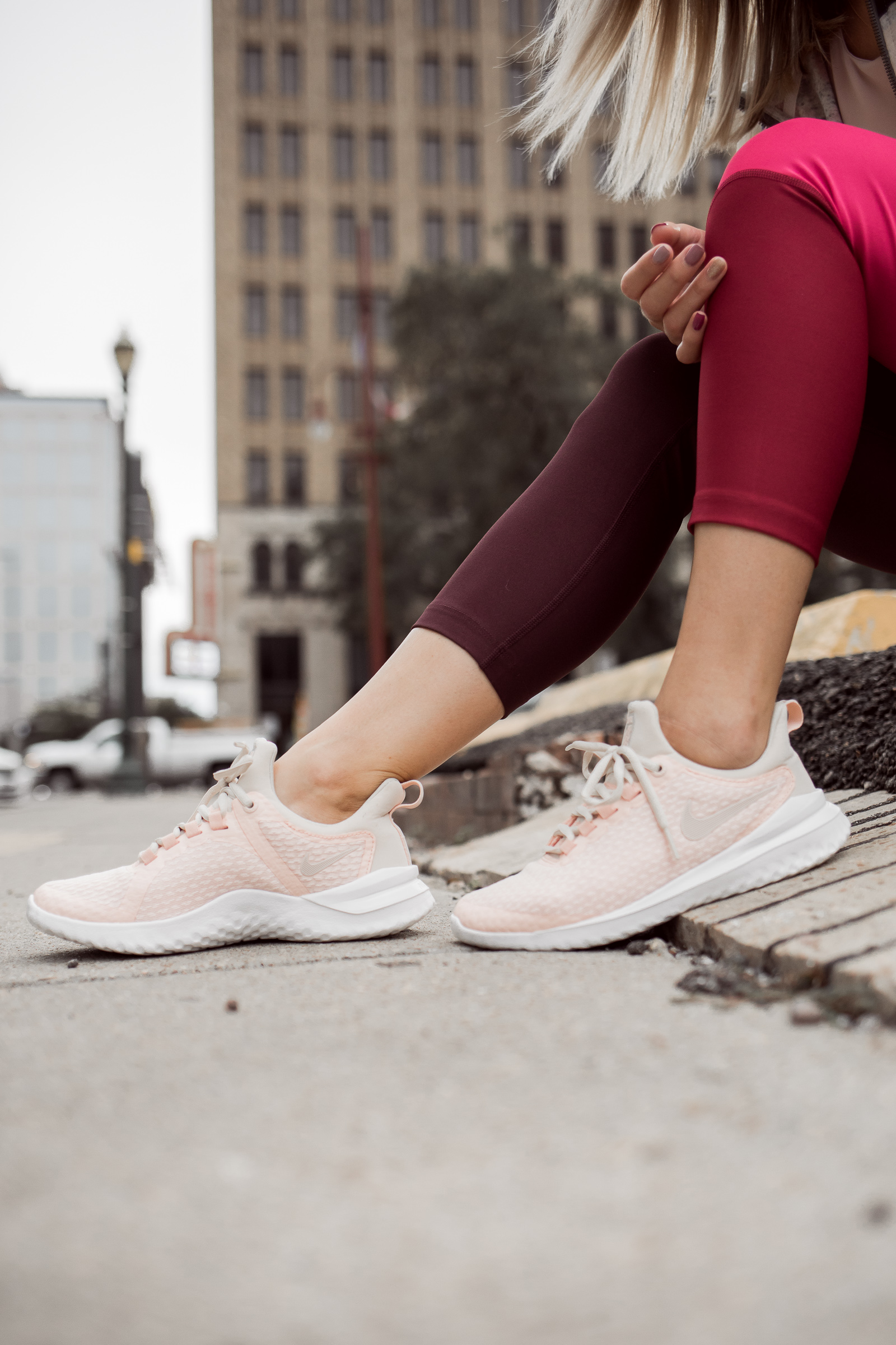 Houston Fashion blogger Uptown with Elly Brown wears pink running shoes