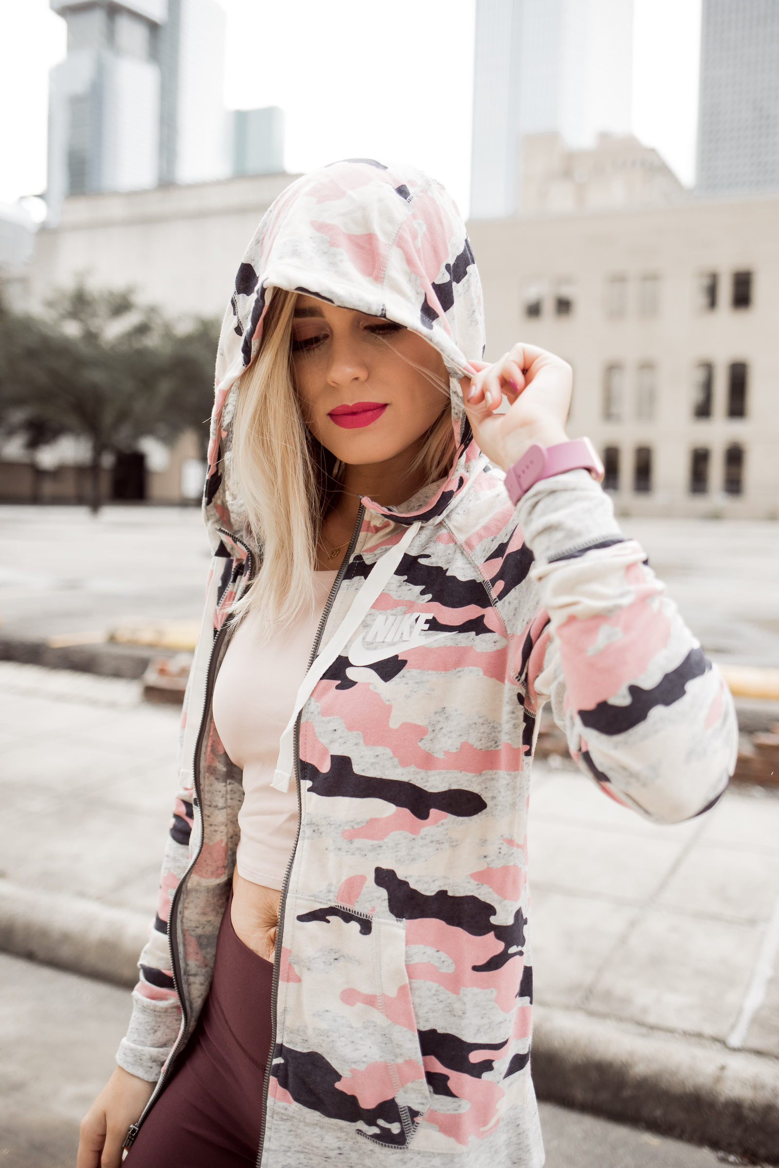 Houston Fashion blogger Uptown with Elly Brown wears pink Nike Camo zip up hoodie