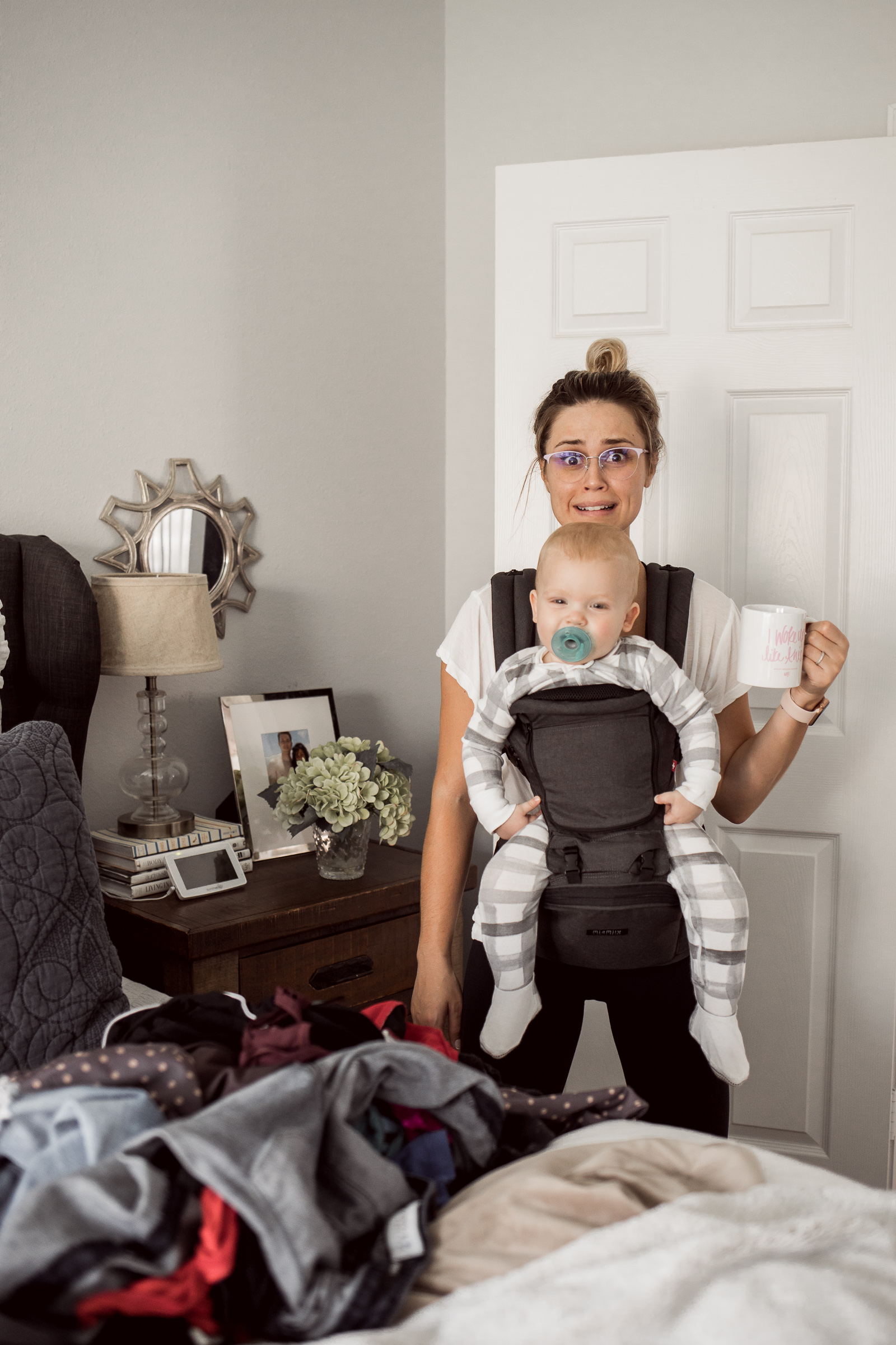 Houston fashion blogger Uptown with Elly Brown wears the MiaMily baby carrier