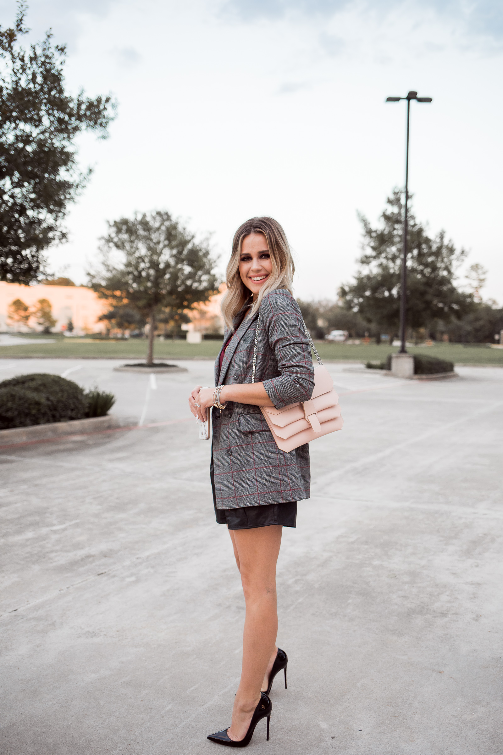 Houston Fashion blogger Uptown with Elly Brown wears a plaid blazer outfit