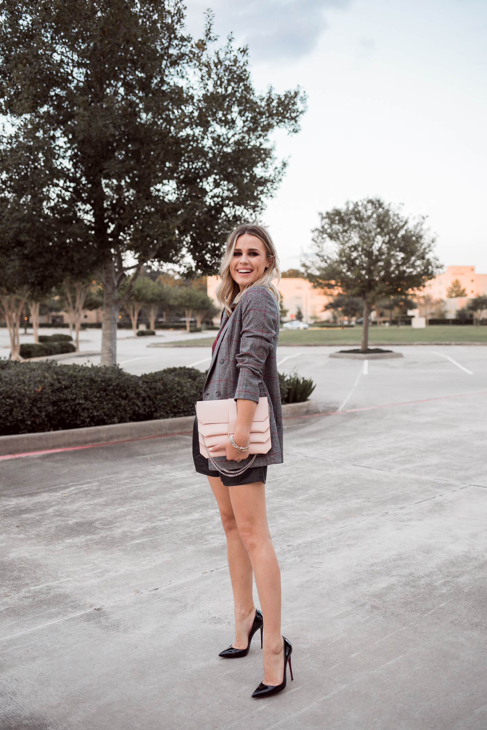 Houston Fashion blogger Uptown with Elly Brown wears a faux leather shorts