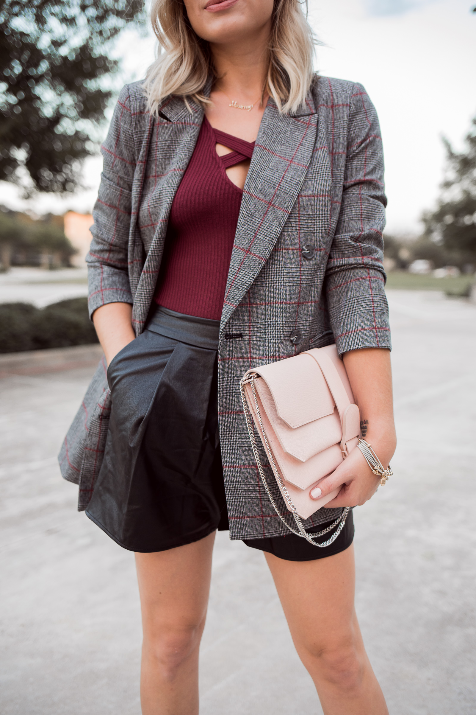 Houston Fashion blogger Uptown with Elly Brown wears a faux leather shorts with a blazer
