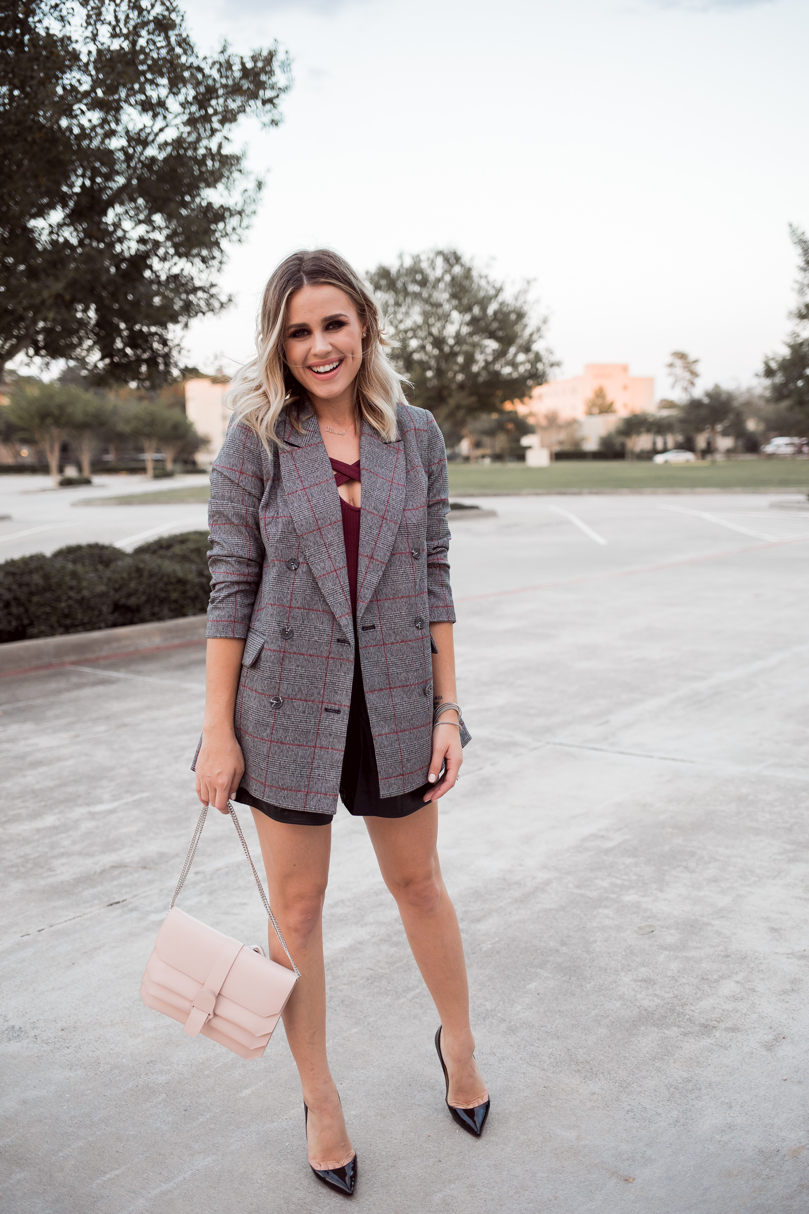 Houston Fashion blogger Uptown with Elly Brown wears a faux leather shorts with a plaid blazer