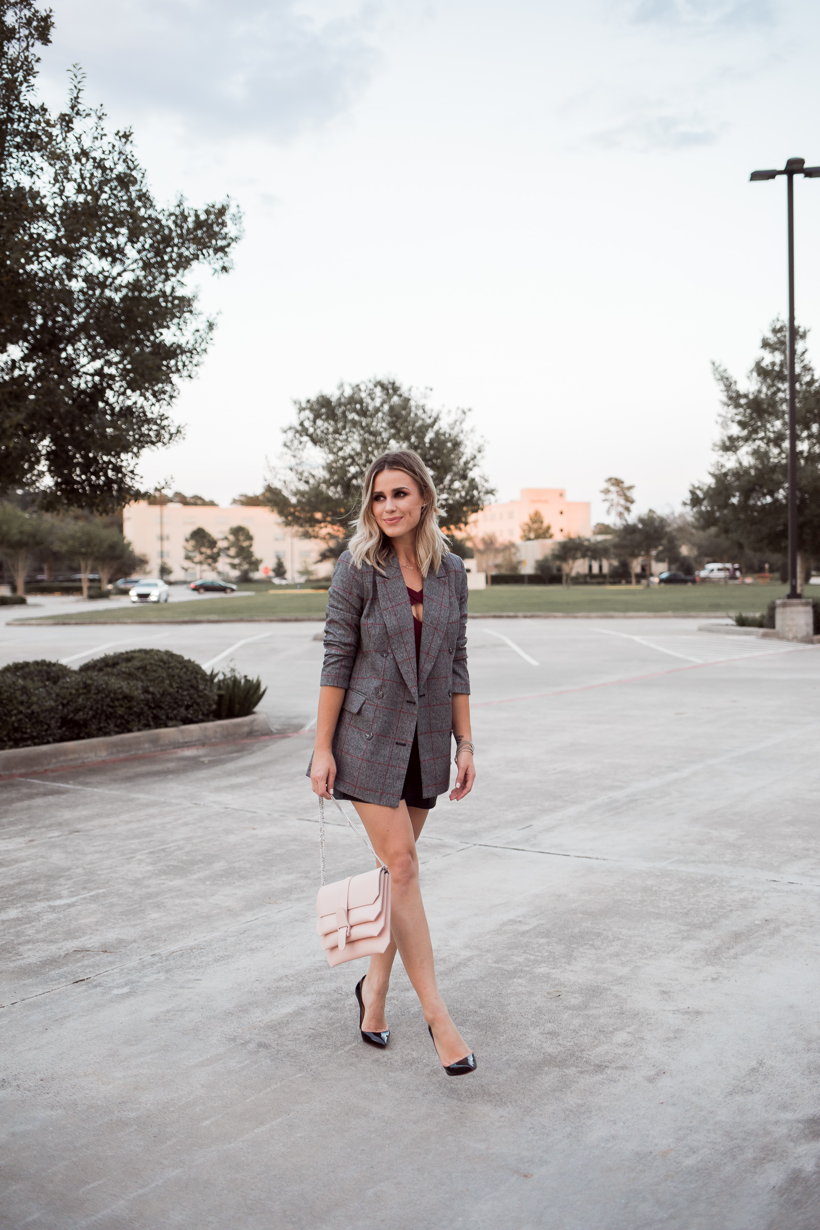 Houston Fashion blogger Uptown with Elly Brown shares how she wears a Plaid Blazer and a list of her must read books for the girl boss.