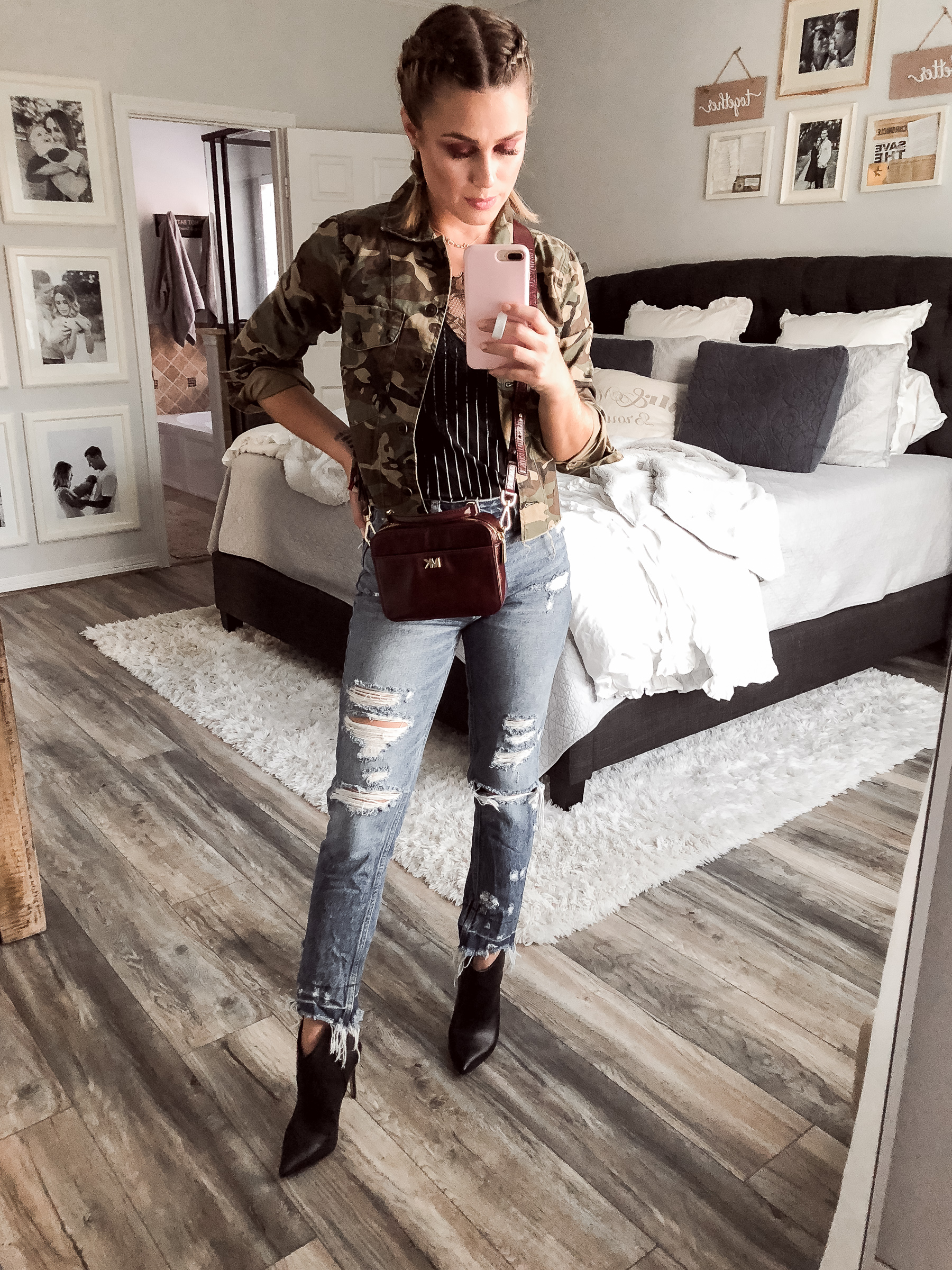 Houston fashion blogger Uptown with Elly Brown wears mom jeans and a cropped camo jacket
