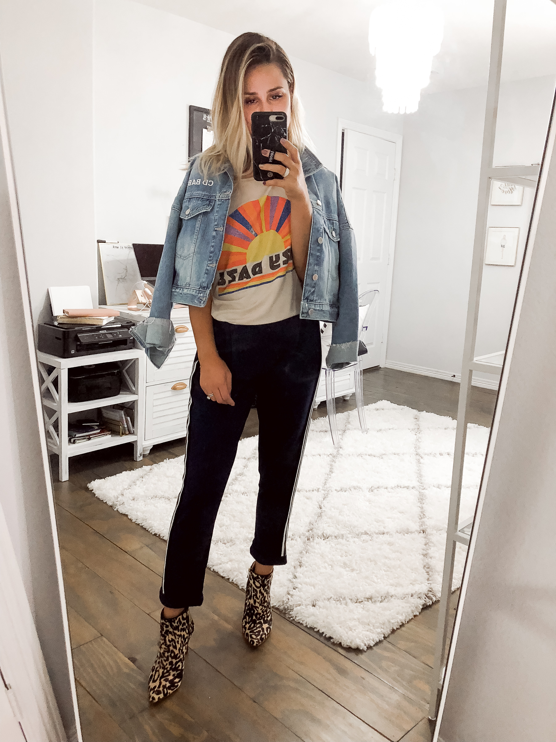 Houston fashion blogger Uptown with Elly Brown wears track pants with leopard ankle boots