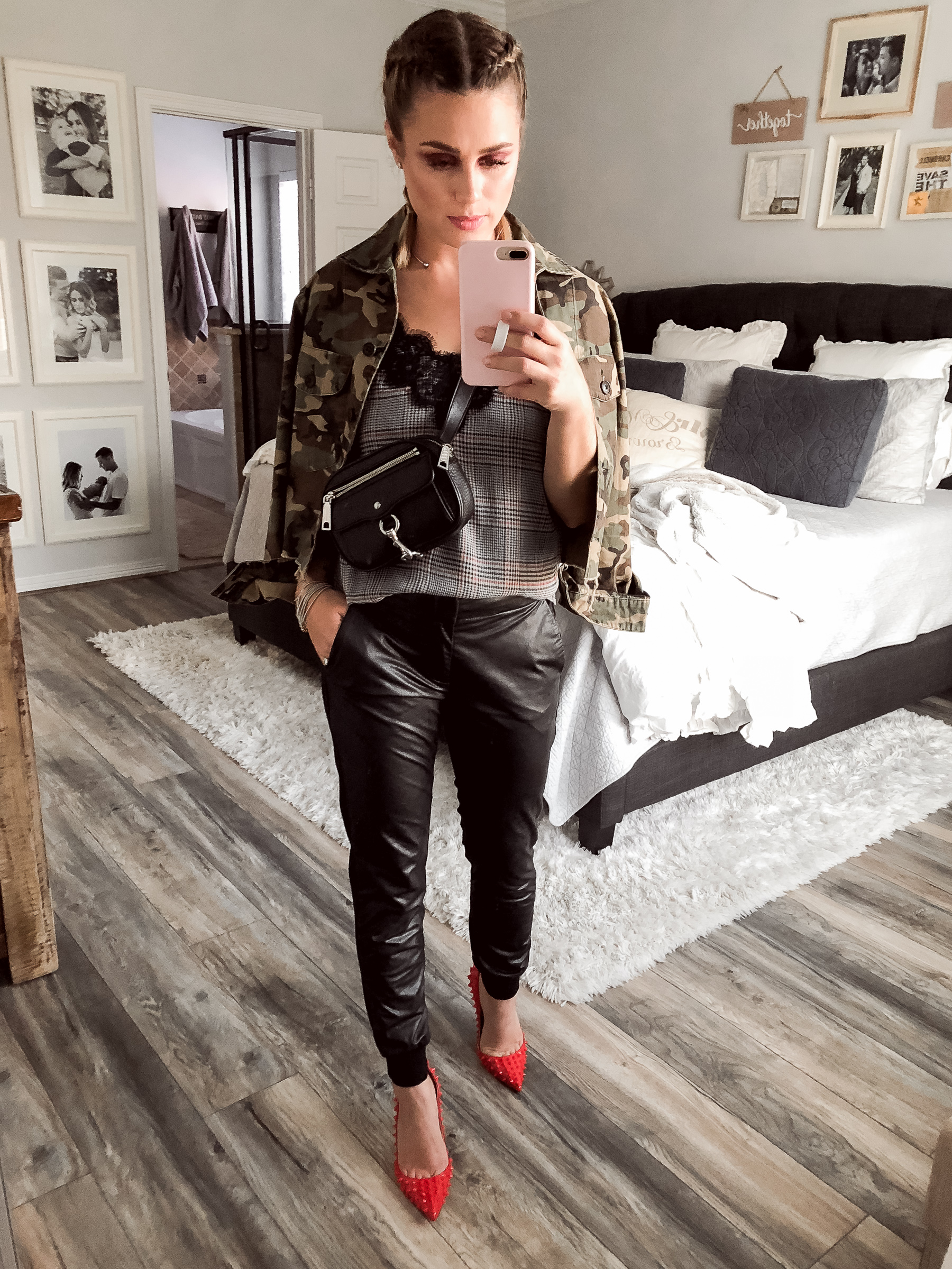 Houston fashion blogger Uptown with Elly Brown wears faux leather joggers and plaid tank top