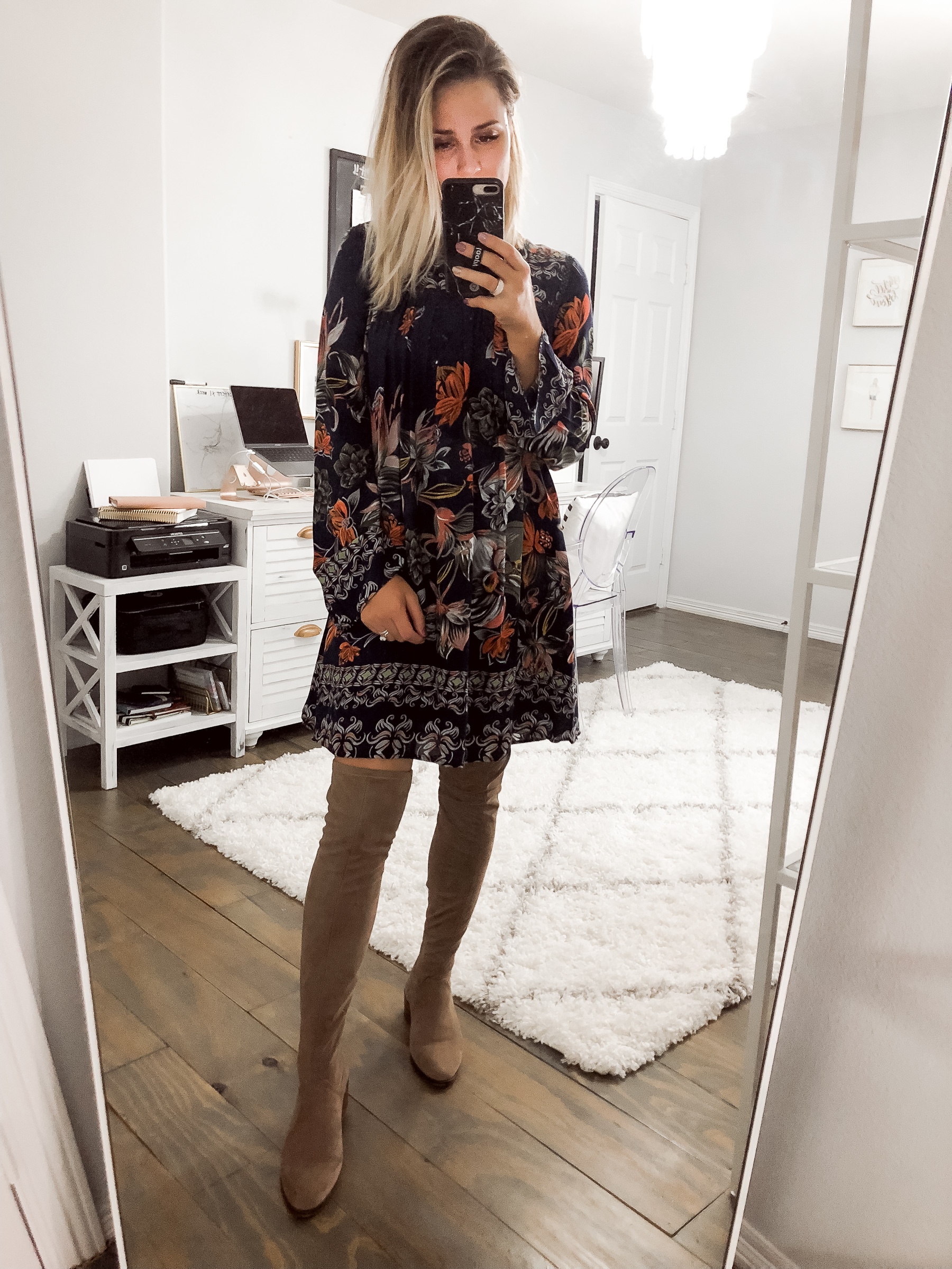Houston fashion blogger Uptown with Elly Brown wears a navy fall floral dress and over-the-knee boots