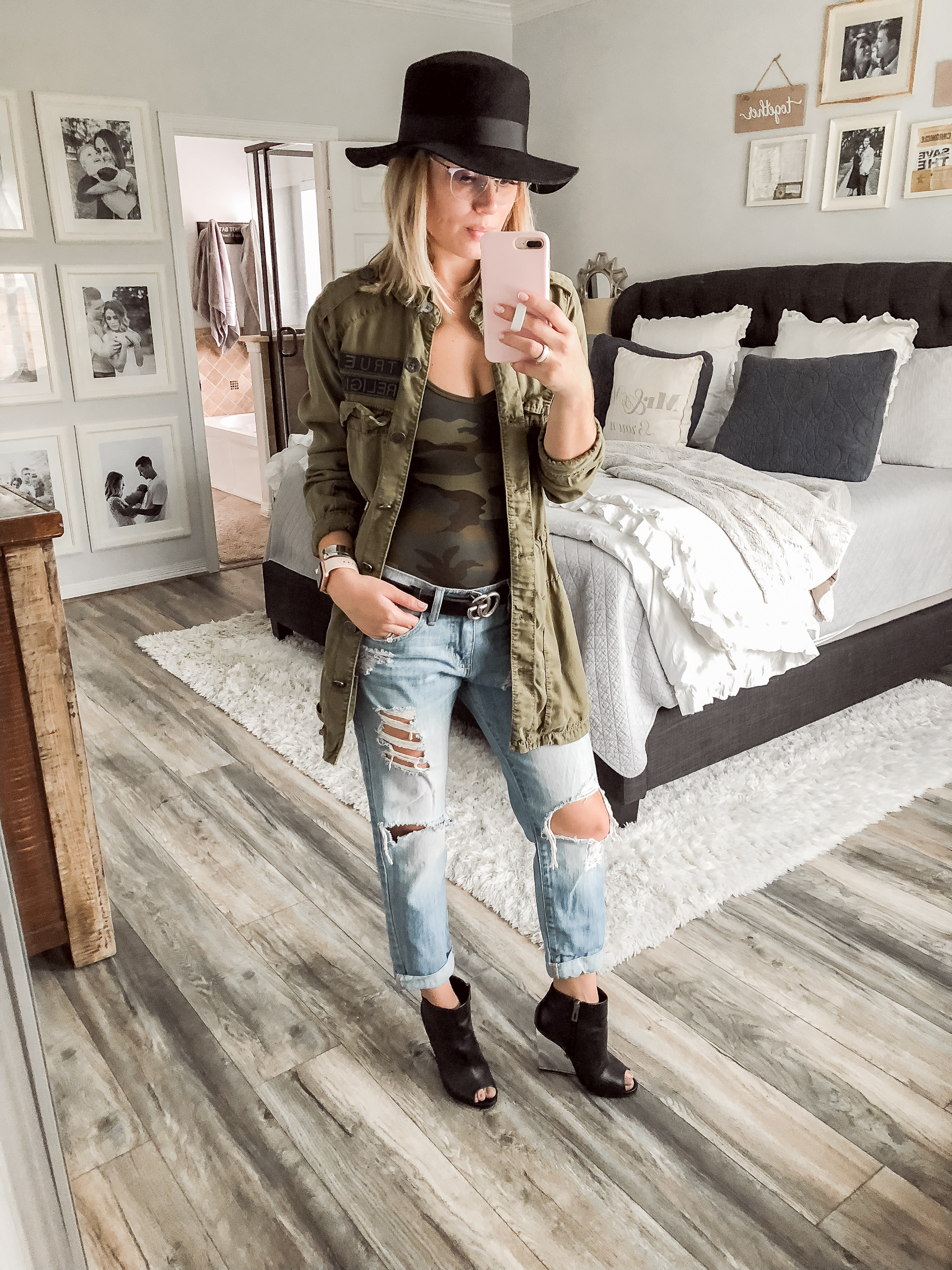 Houston fashion blogger Uptown with Elly Brown wears girlfriend denim with a camo bodysuit
