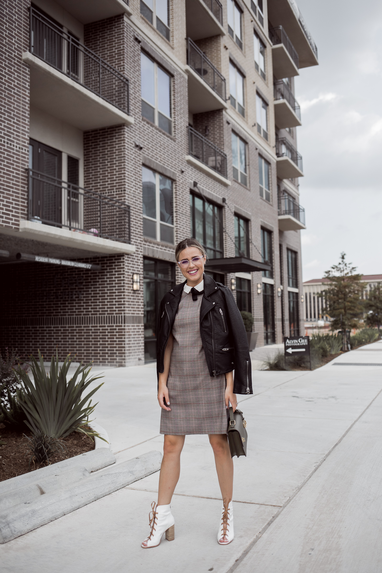 Houston fashion blogger Uptown with Elly Brown wears white lace up ankle boots for fall