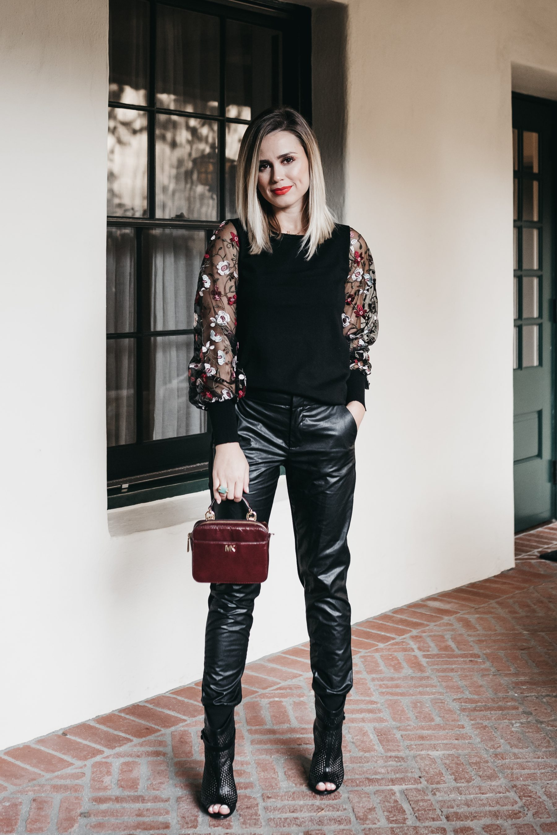 Houston fashion blogger Uptown with Elly Brown dresses up a Faux Leather Joggers for the fall with peep toe booties