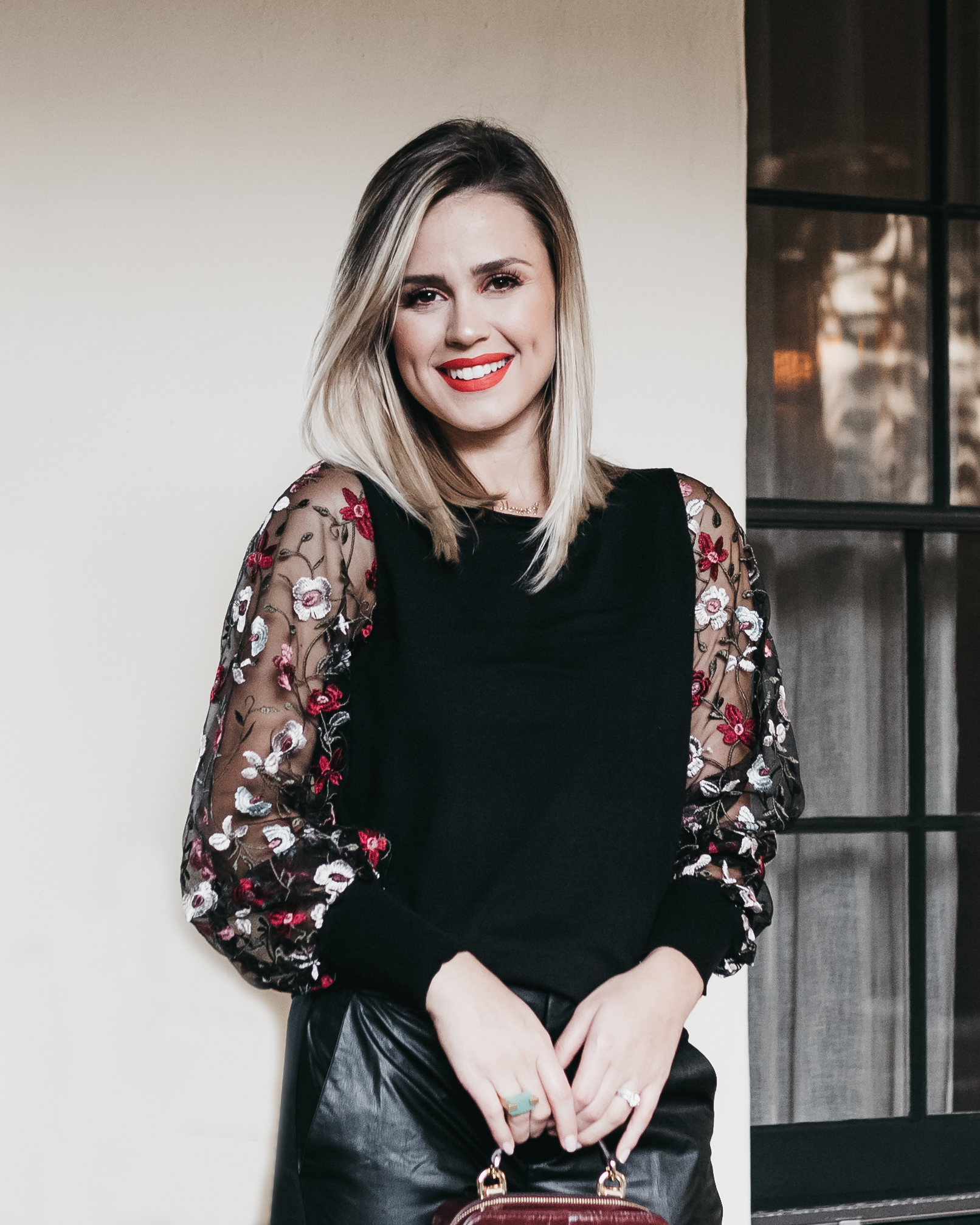 Houston fashion blogger Uptown with Elly Brown wears a CeCe Embroidered Sleeve Sweater