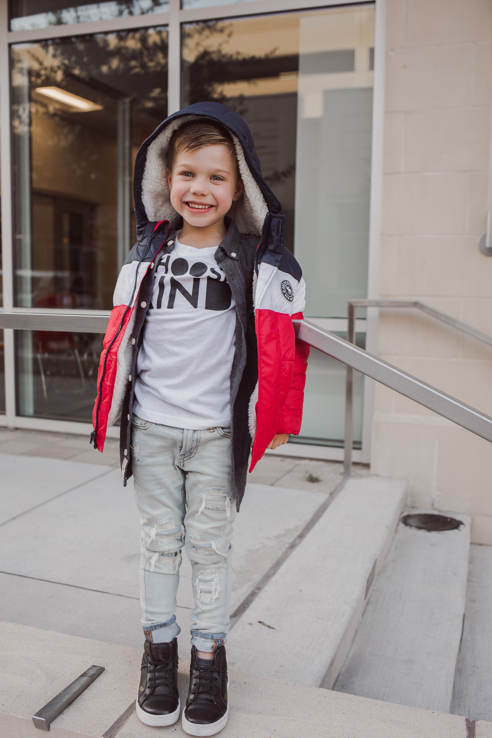 Houston lifestyle blogger Uptown with Elly Brown son wears an essential puffer jacket from Abercrombie Kids