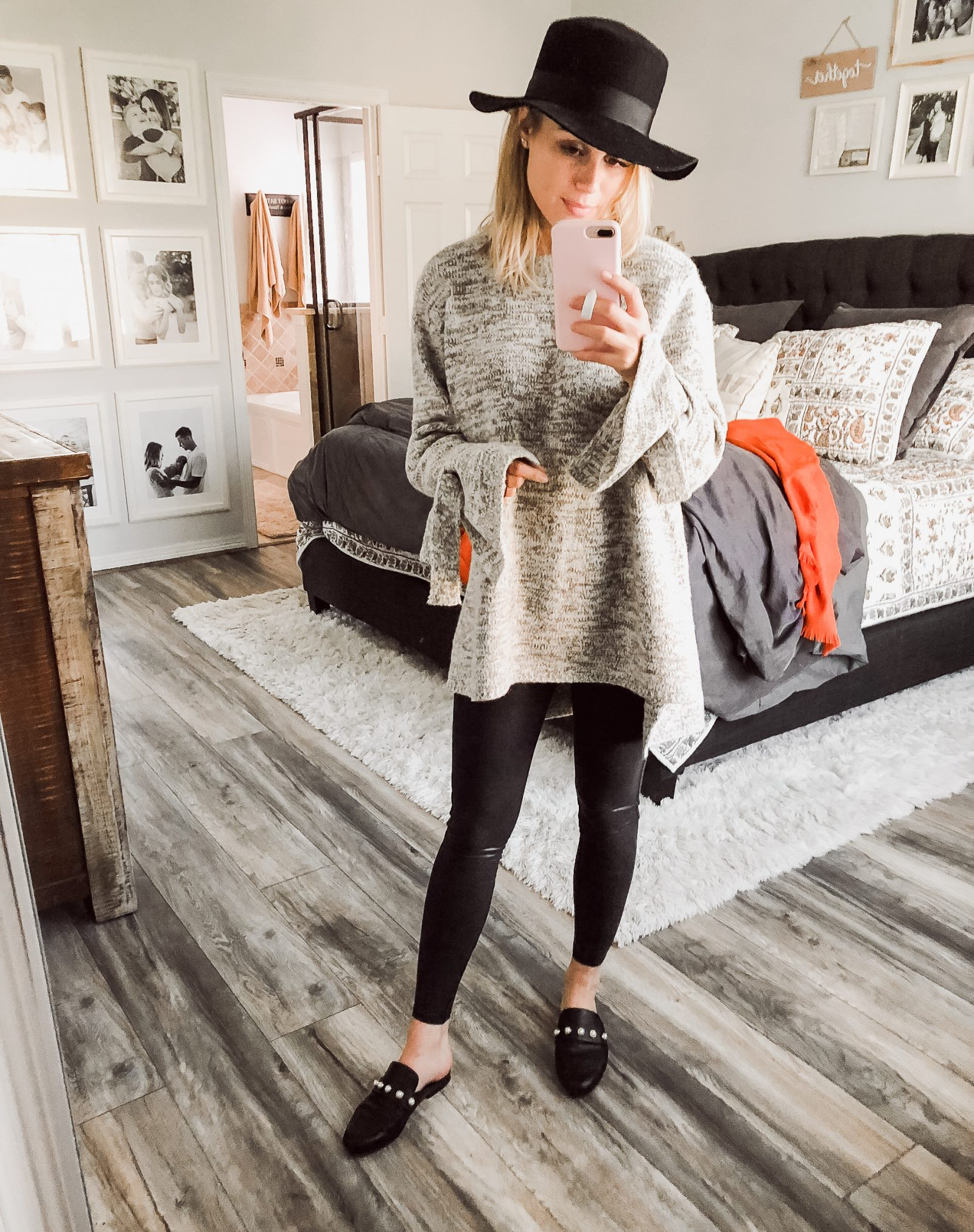 Houston beauty blogger Uptown with Elly Brown wears an oversized sweater with faux leather leggings