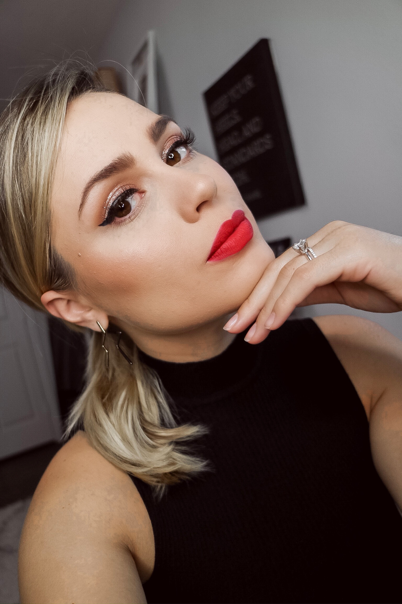 Houston beauty blogger Uptown with Elly Brown wears a festive holiday makeup look with a bold red lip