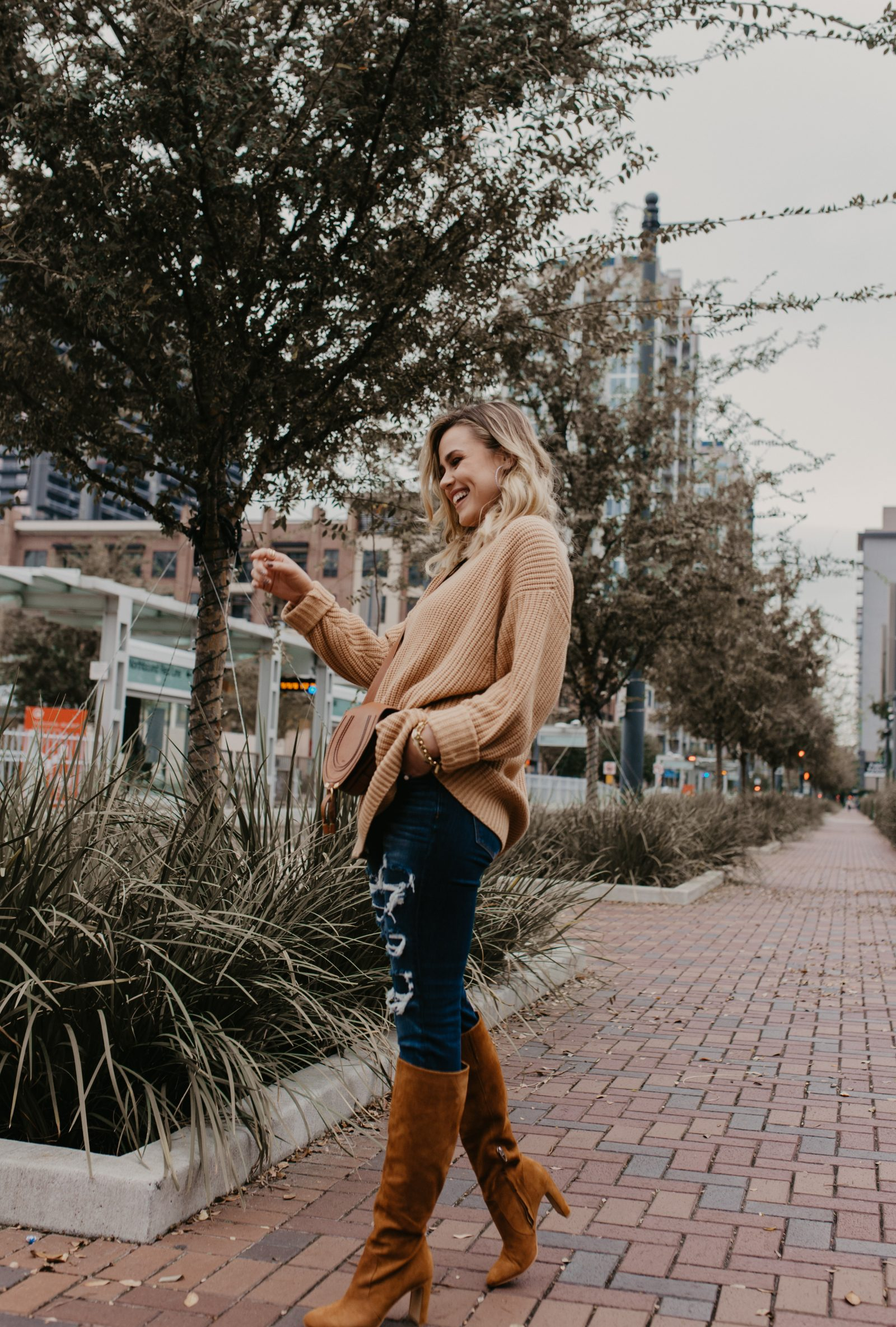 Houston Fashion blogger Uptown with Elly Brown wears a cozy knit sweater with jeggings from American Eagle