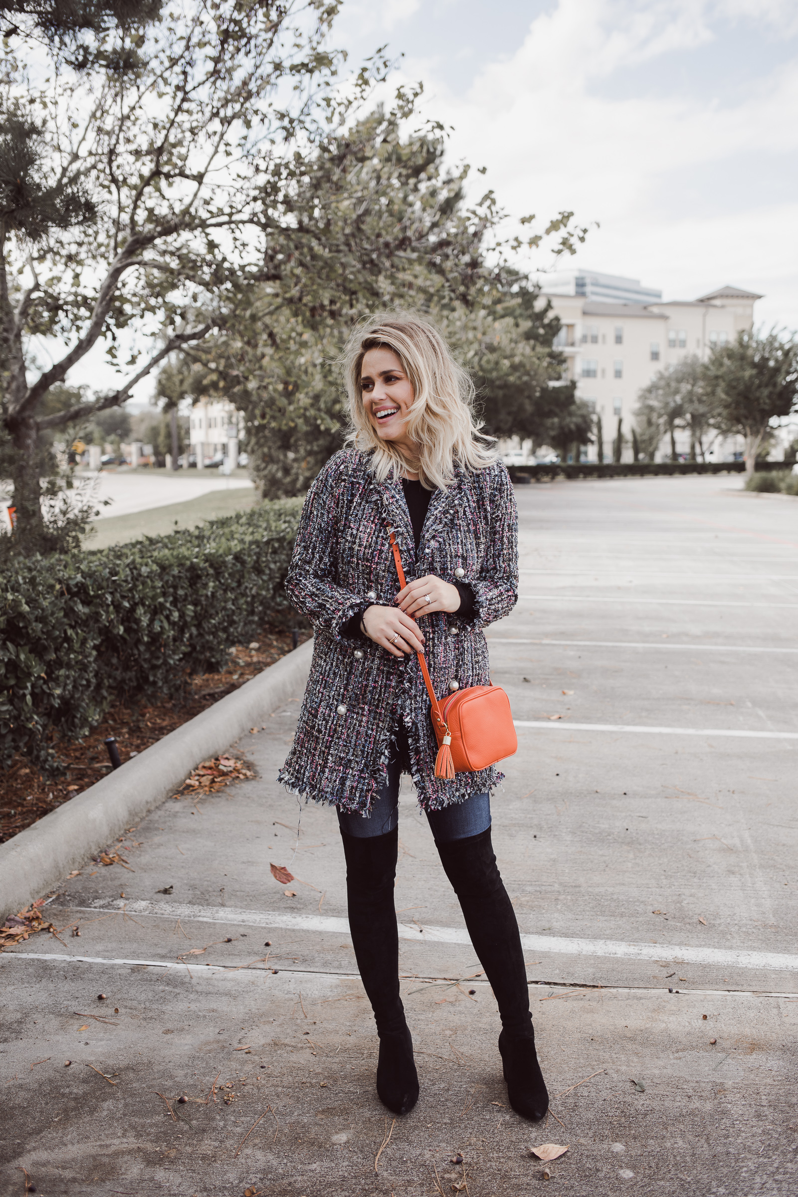 Houston fashion blogger Uptown with Elly Brown wears over the knee boots with a tweed jacket