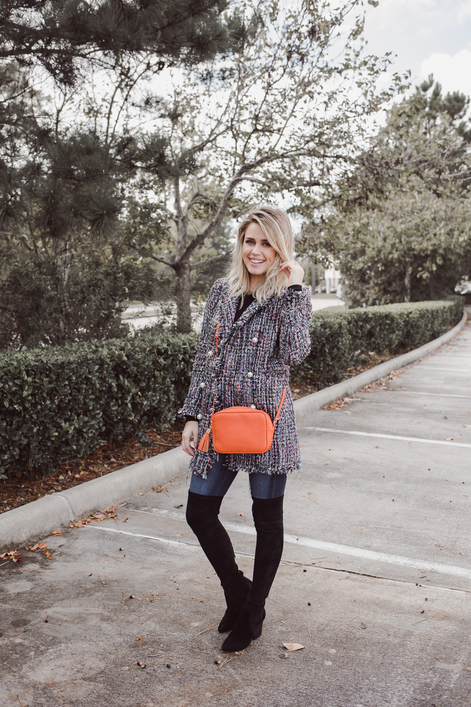 Houston fashion blogger Uptown with Elly Brown shares how to style a Tweed Jacket casually for Fall with over the knee boots.