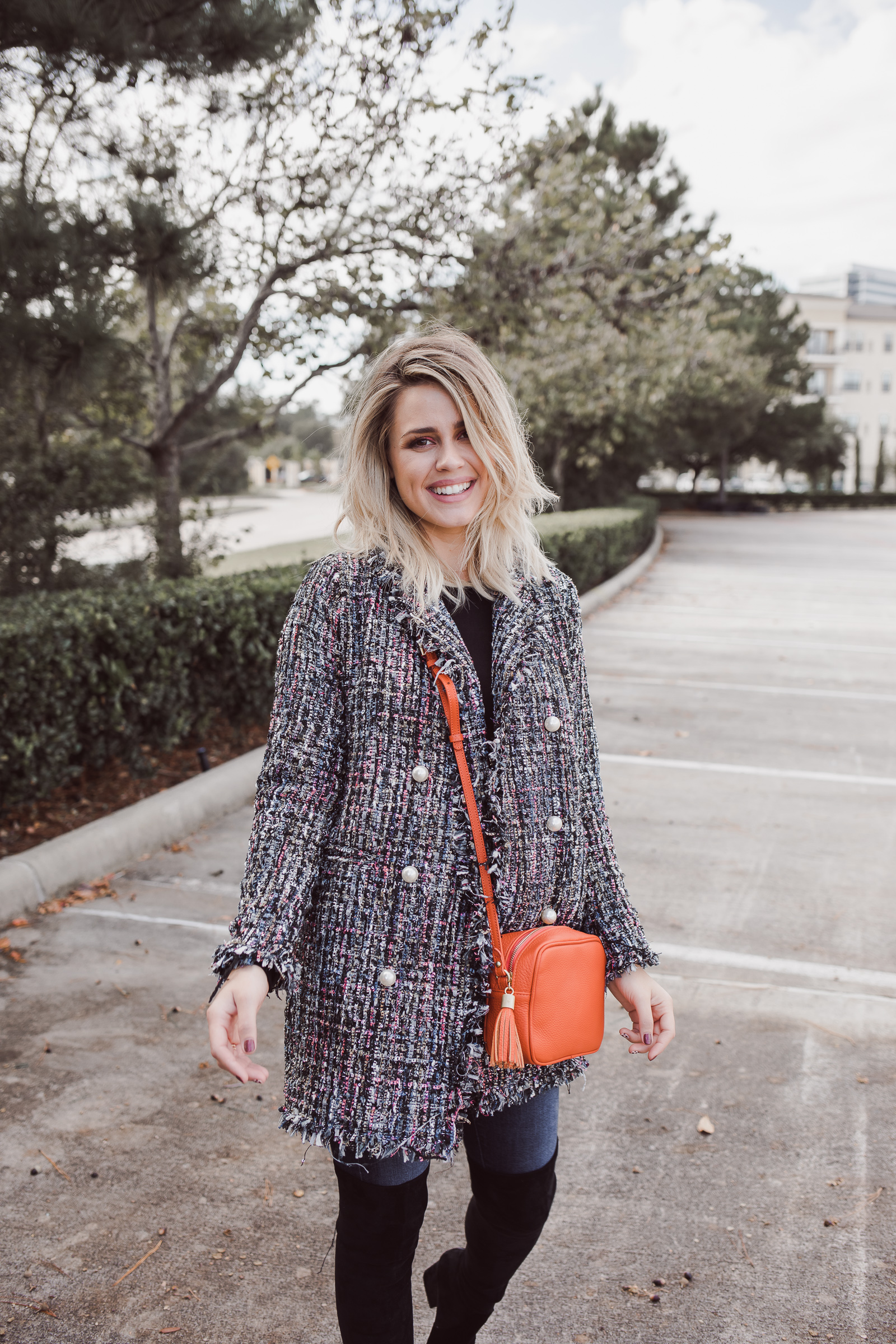 Houston fashion blogger Uptown with Elly Brown wears a Tweed Jacket casually with denim.