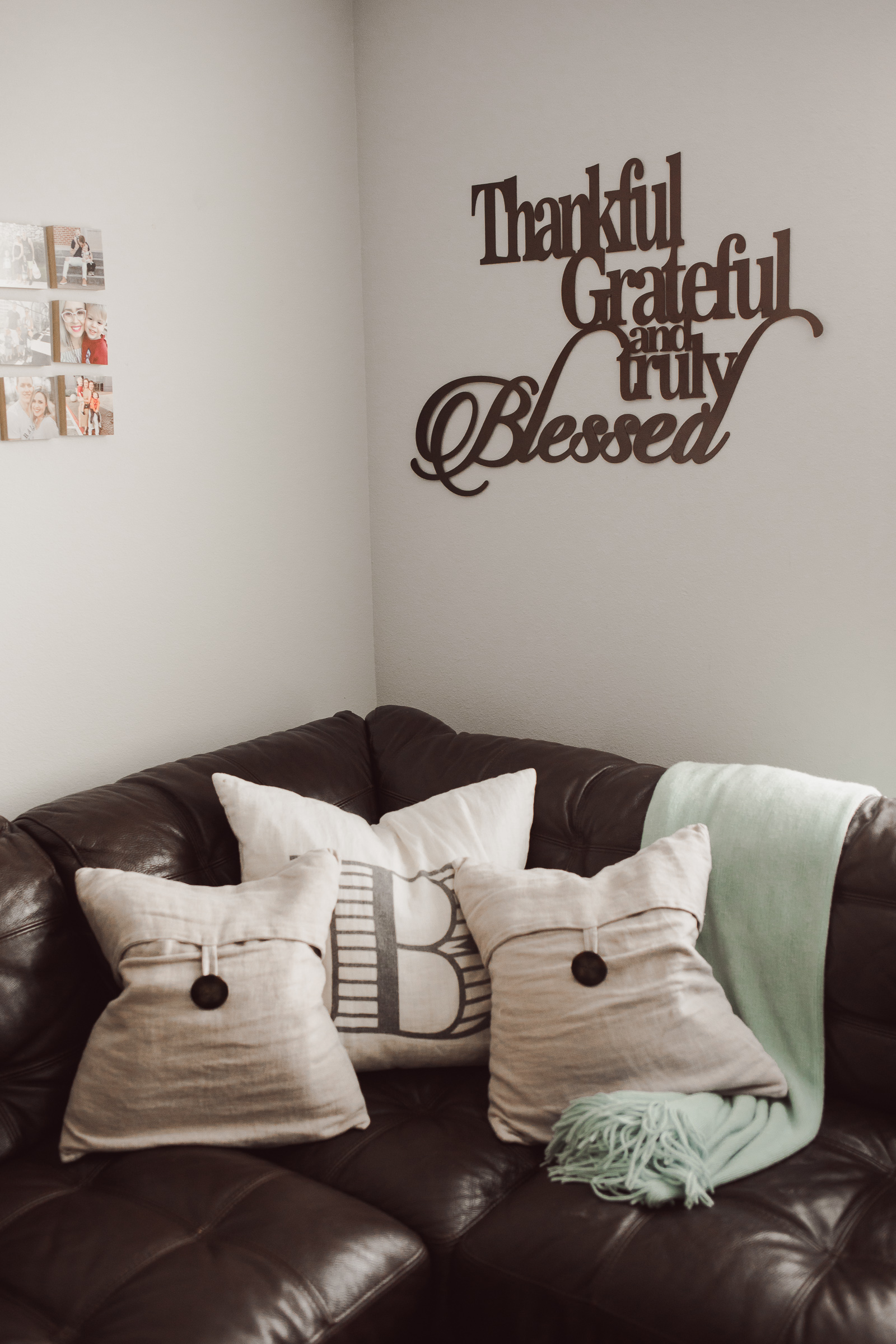 Houston lifestyle blogger Uptown with Elly Brown shares a metal wall art plaque in her game room