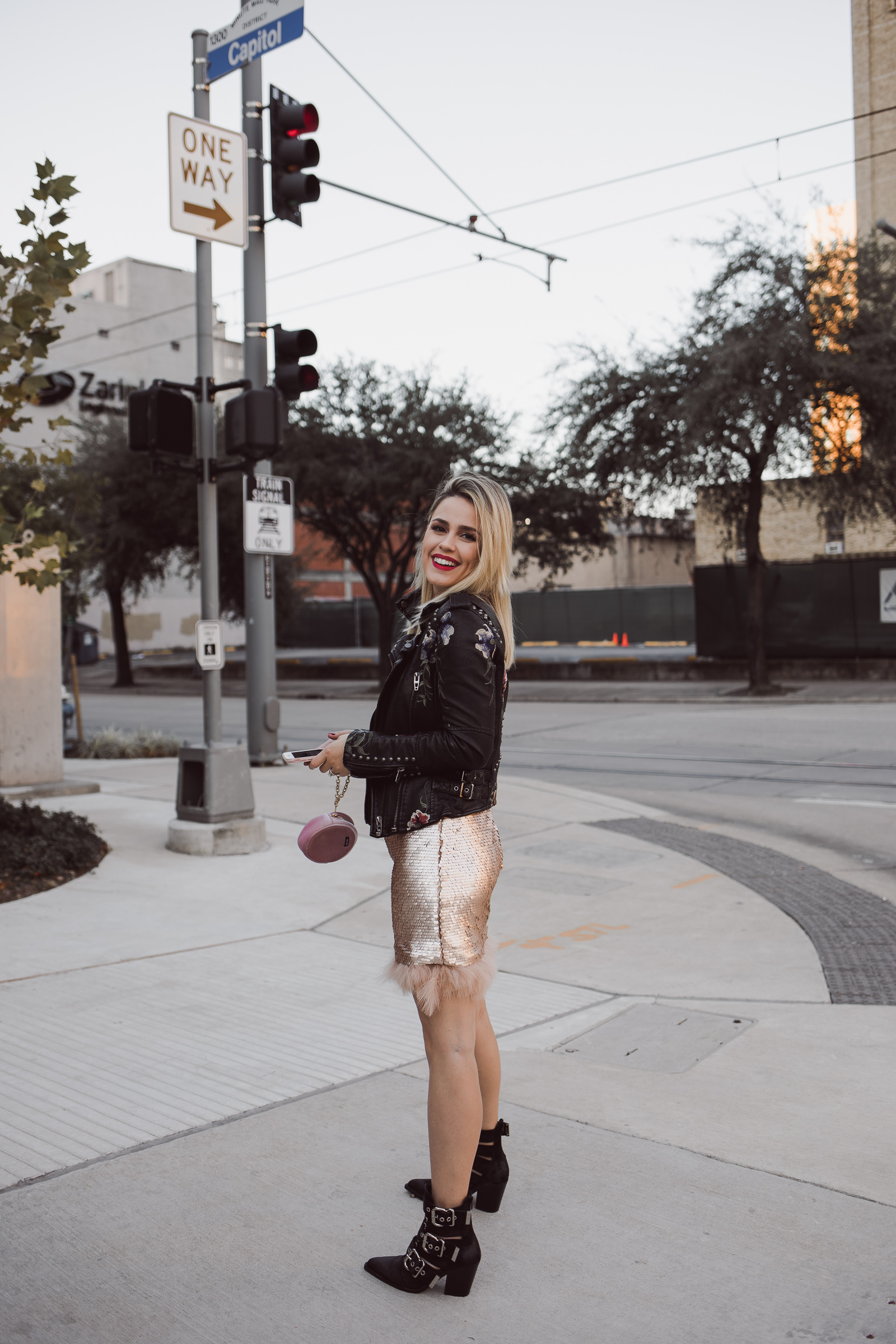 Houston Fashion blogger Uptown with Elly Brown wears a sequin dress with a leather jacket
