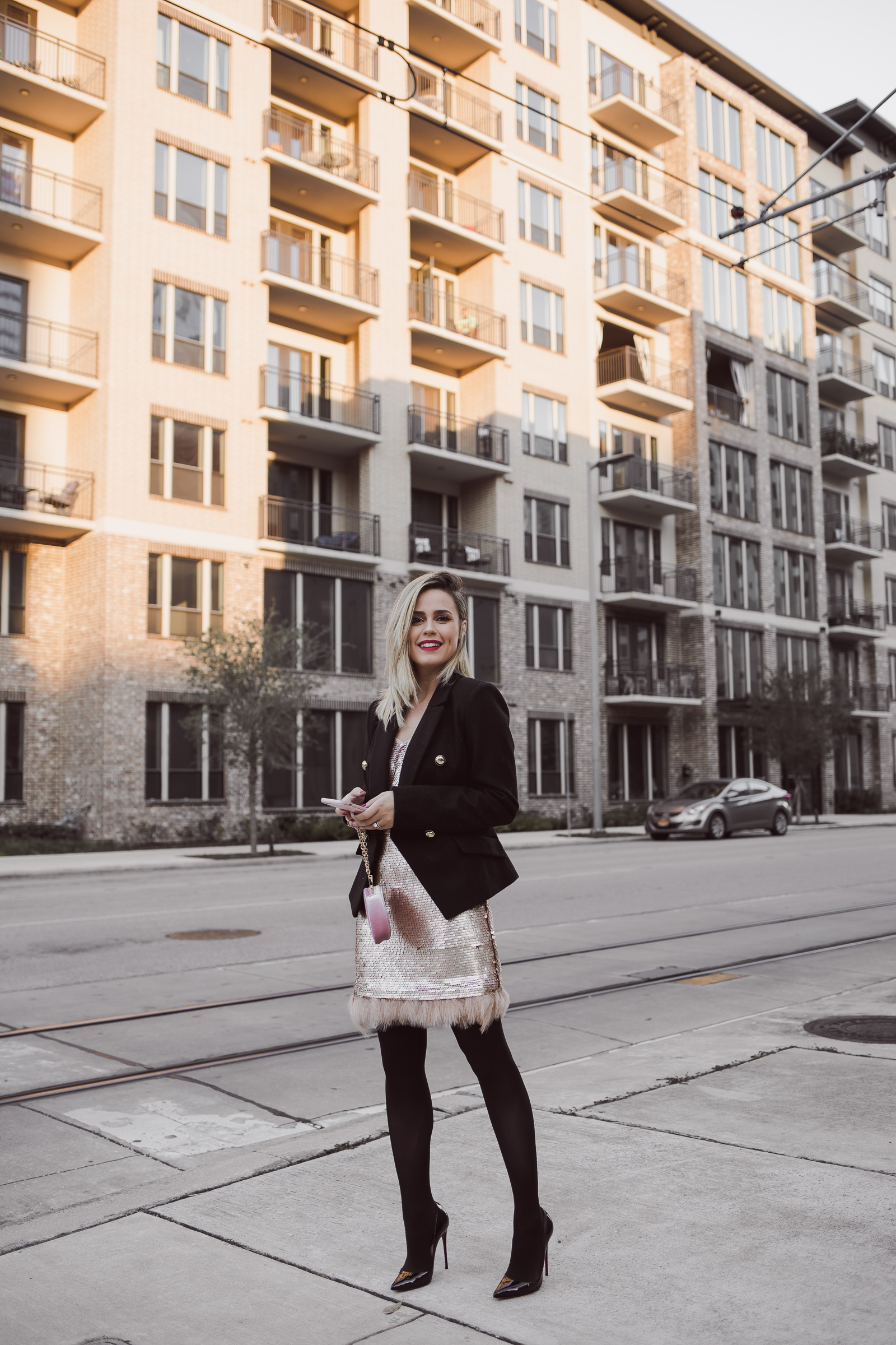 Houston Fashion blogger Uptown with Elly Brown wears a sequin dress with a wool blazer