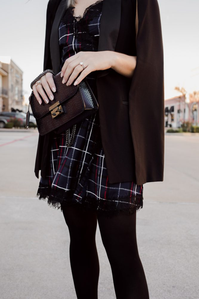 Houston fashion blogger Uptown with Elly Brown wears a plaid dress with a tuxedo cape