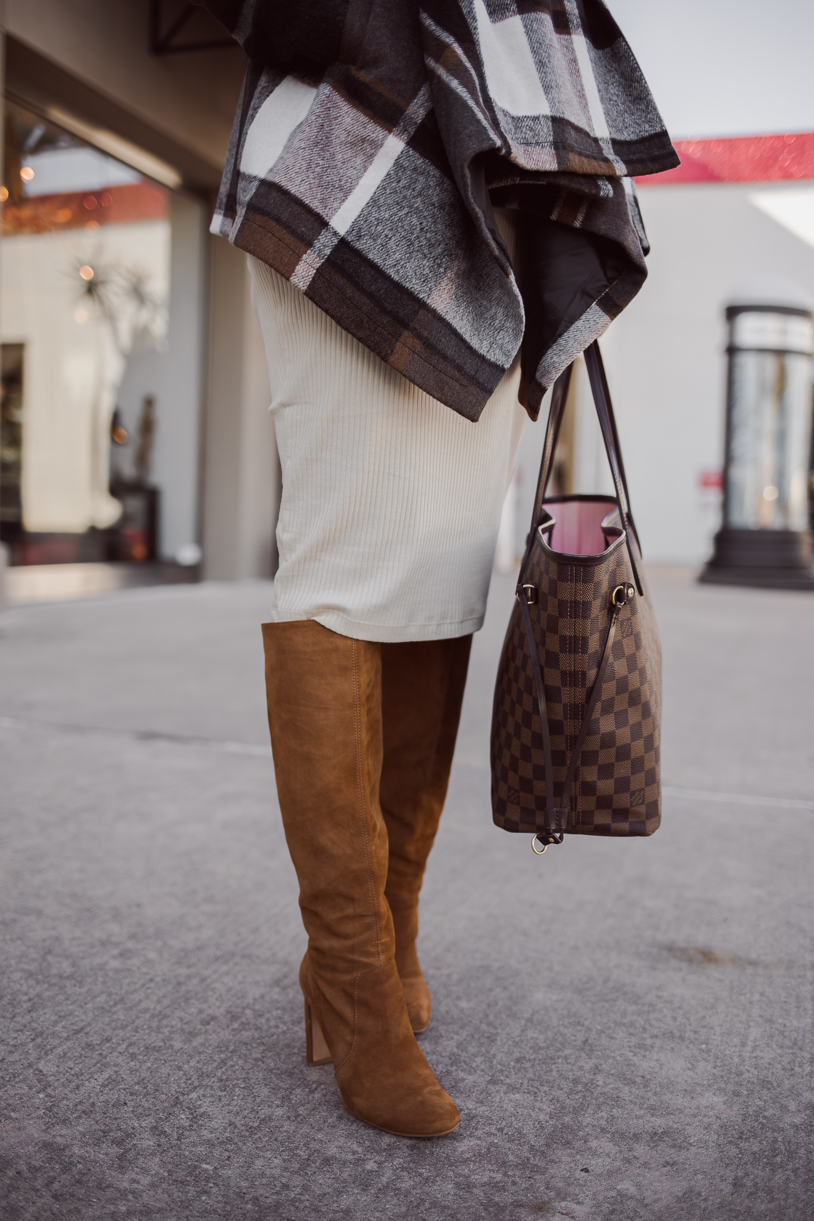 Houston fashion blogger Uptown with Elly Brown wears a Dolce Vita knee high boots for the winter