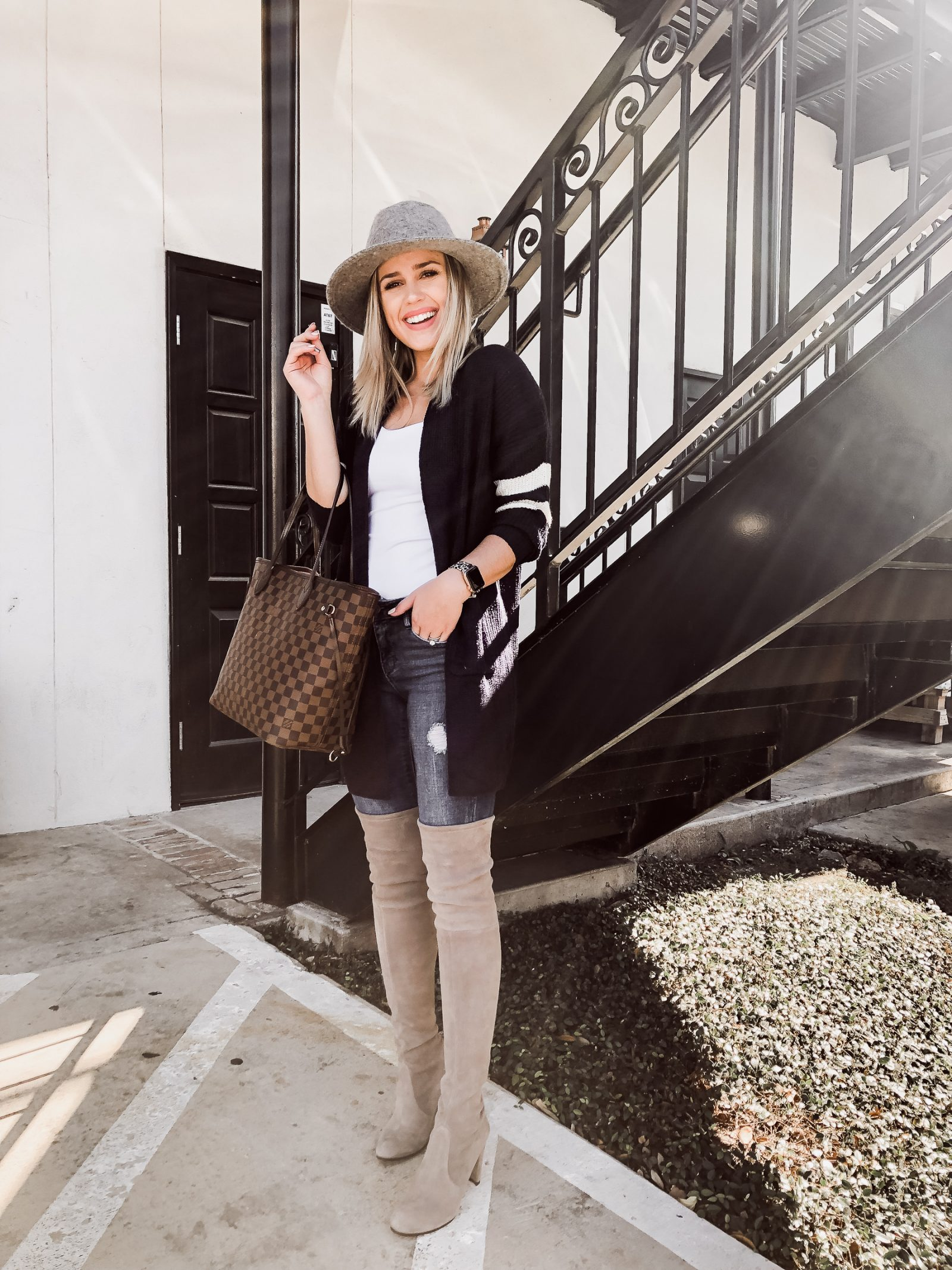 Houston Fashion blogger Uptown with Elly Brown wears over the knew boots with a cardigan