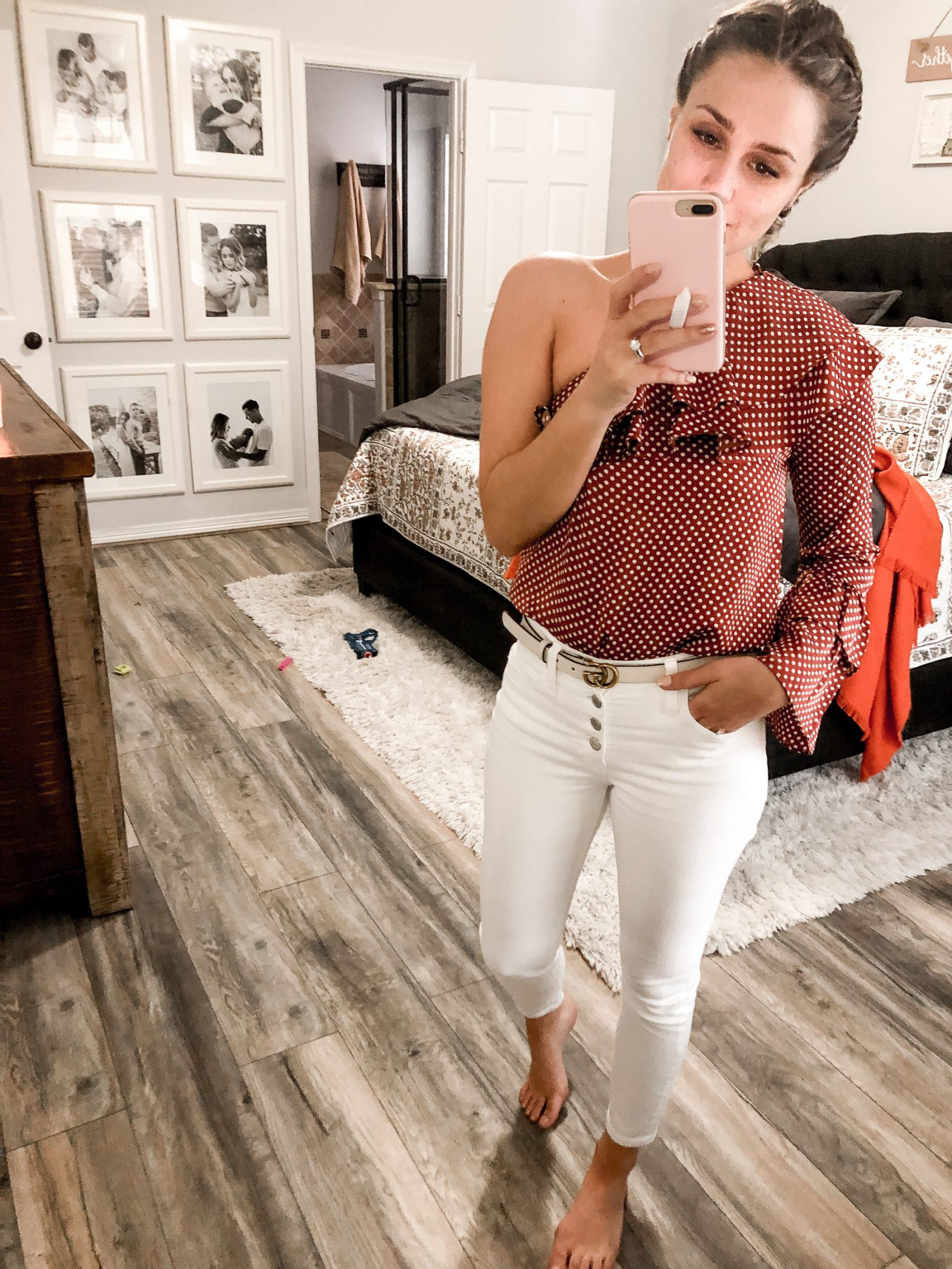 Houston Fashion blogger Uptown with Elly Brown wears white denim and a polka dot top