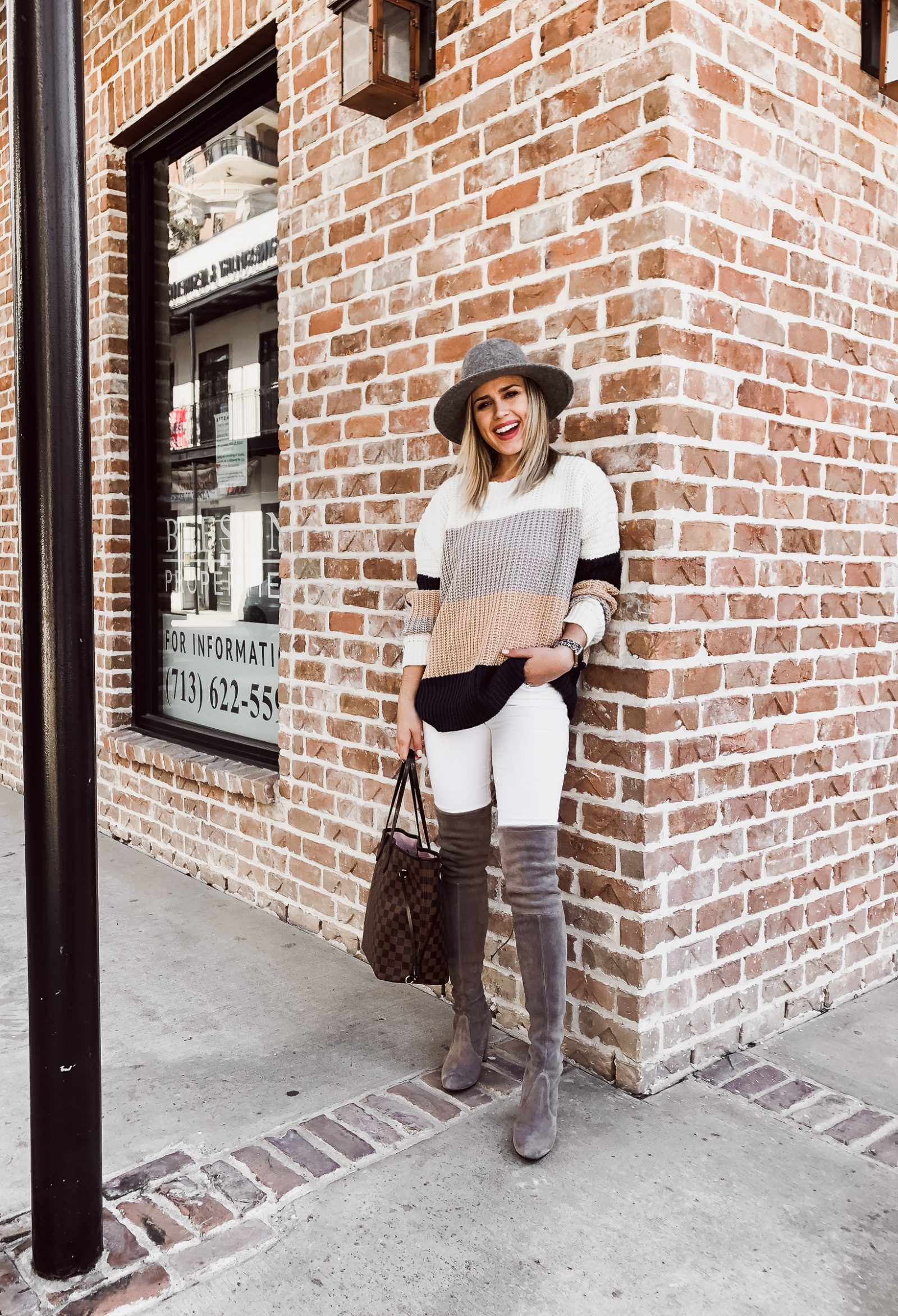 Houston Fashion blogger Uptown with Elly Brown wears a color-block sweater with with denim
