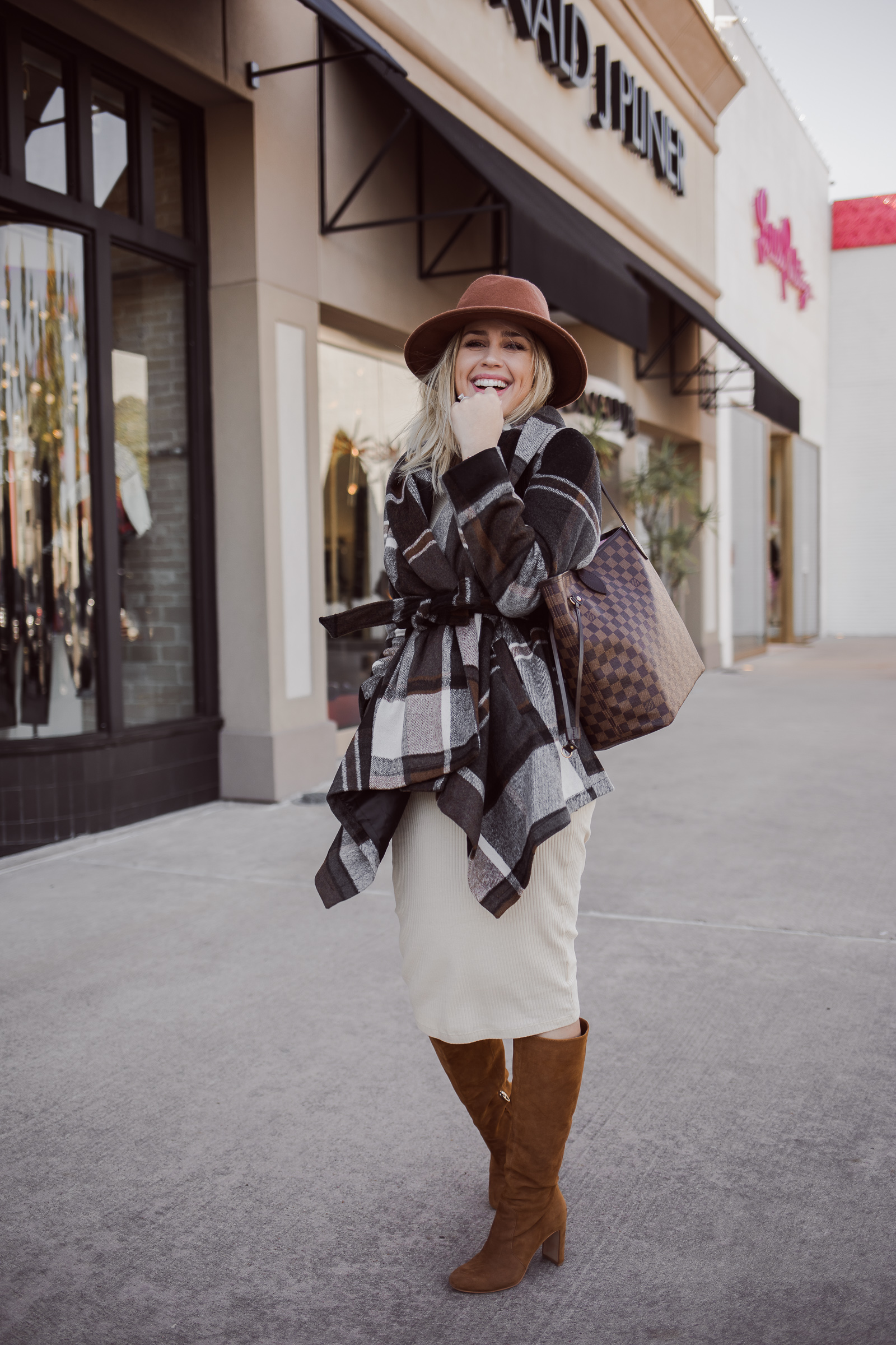 Houston fashion blogger Uptown with Elly Brown wears a Wrap Coat for the winter with a simple dress and knee high boots.