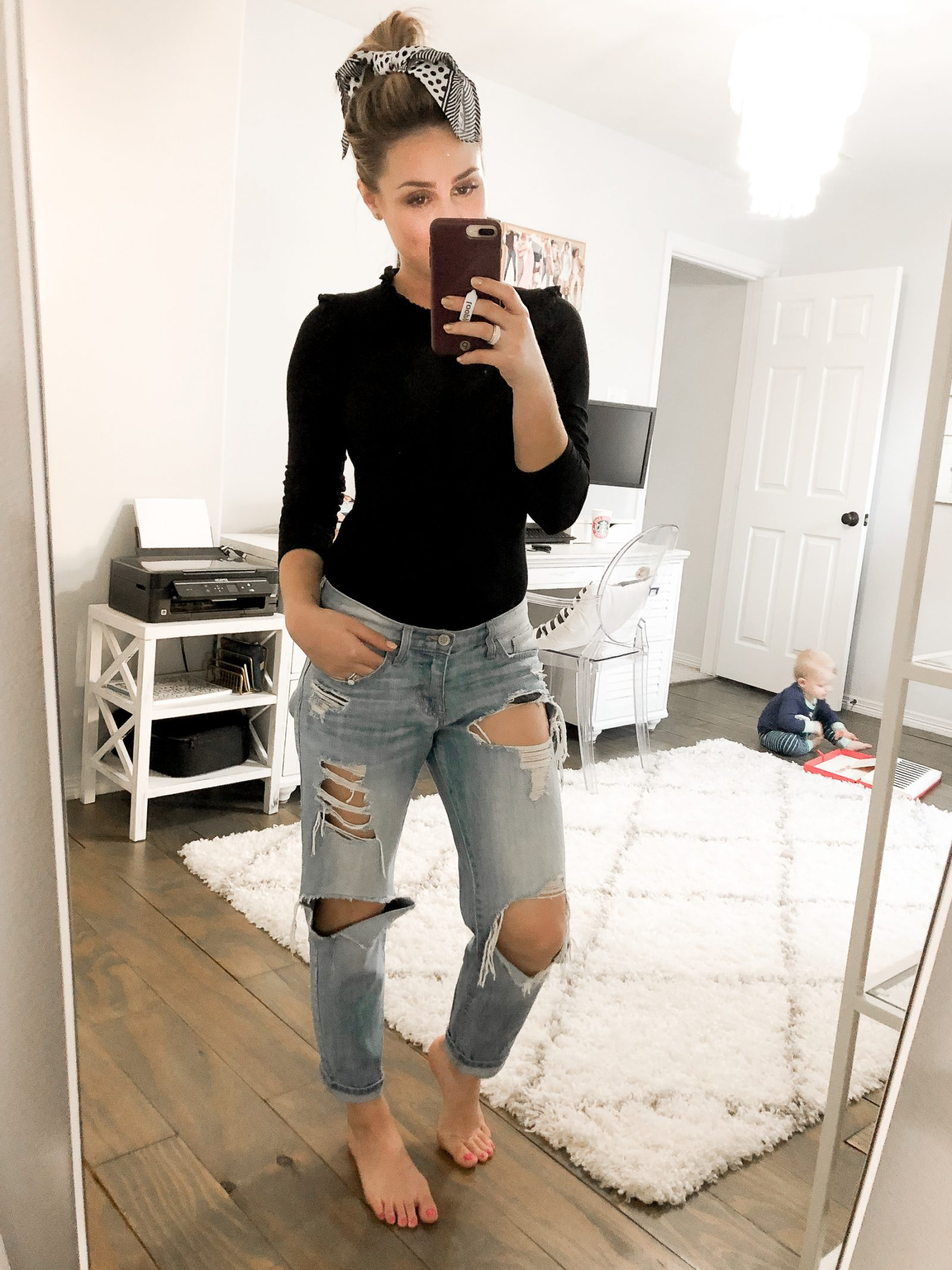 Houston blogger Uptown with Elly Brown wears boyfriend jeans with a long sleeve bodysuit