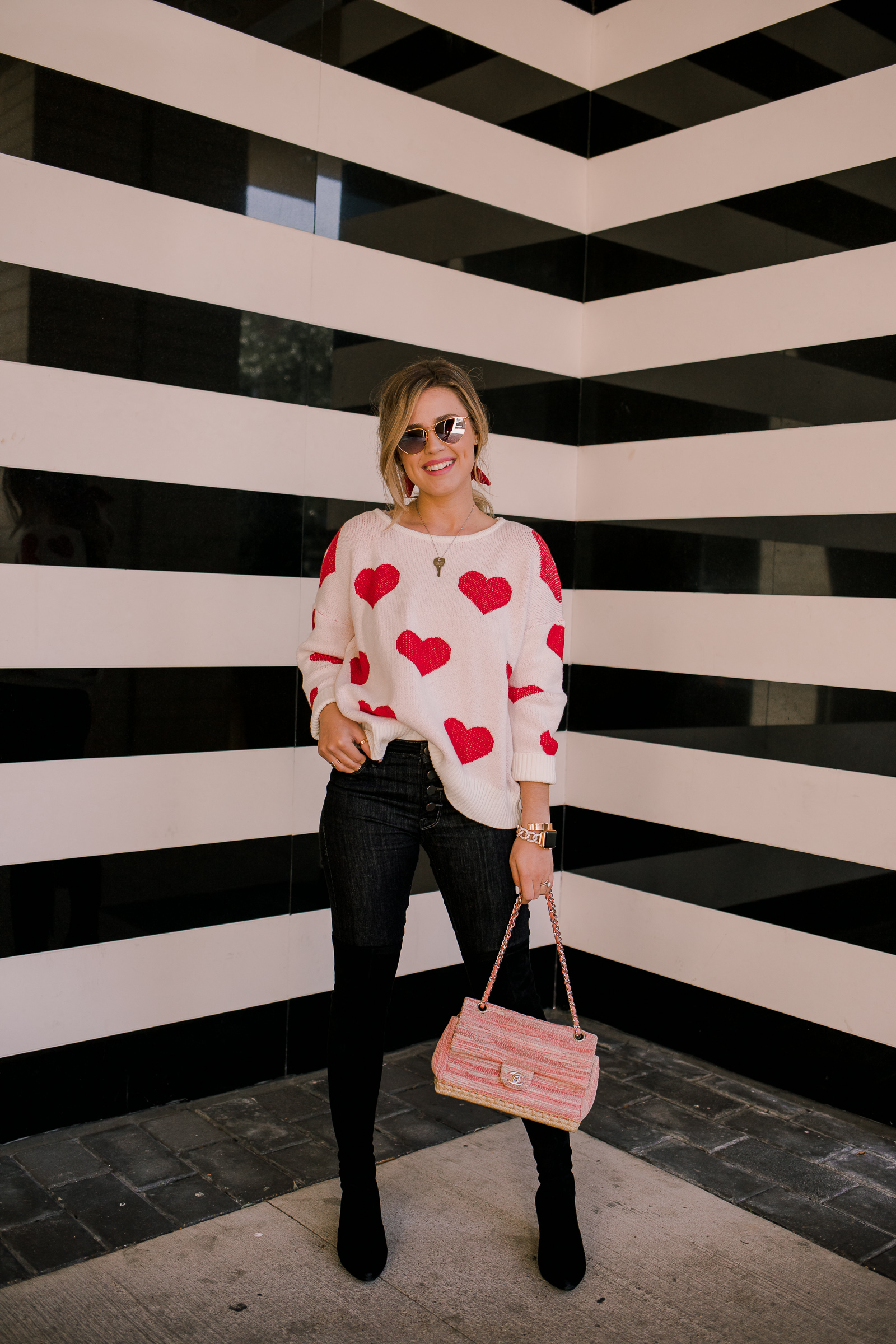 Houston fashion blogger Uptown with Elly Brown wears the perfect heart sweater for Valentine's Day
