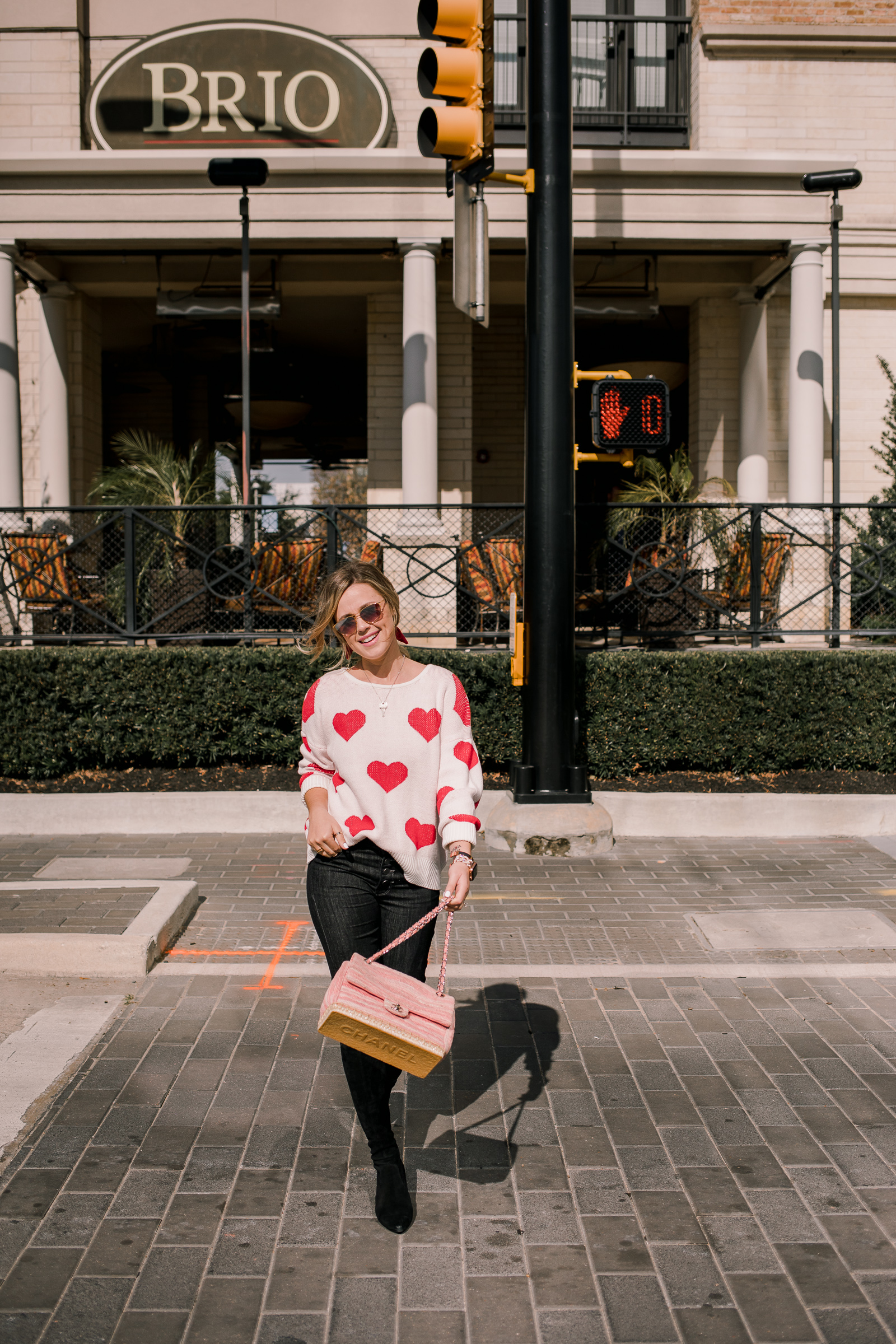 Houston fashion blogger Uptown with Elly Brown shares over 20 Heart Sweaters perfect for Valentine's Day.