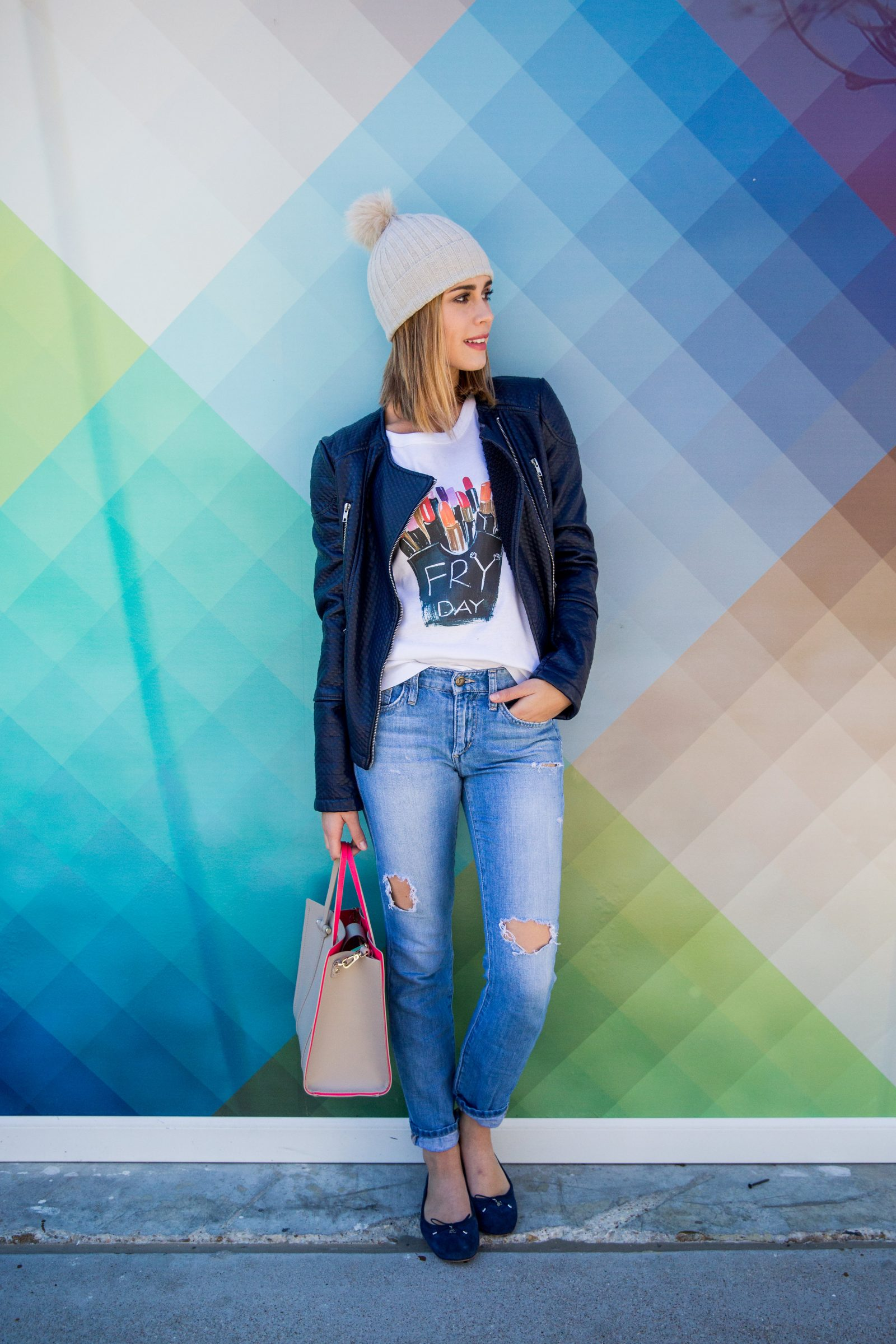 Houston fashion blogger Elly brown wears a FRYday graphic tee with distressed denim