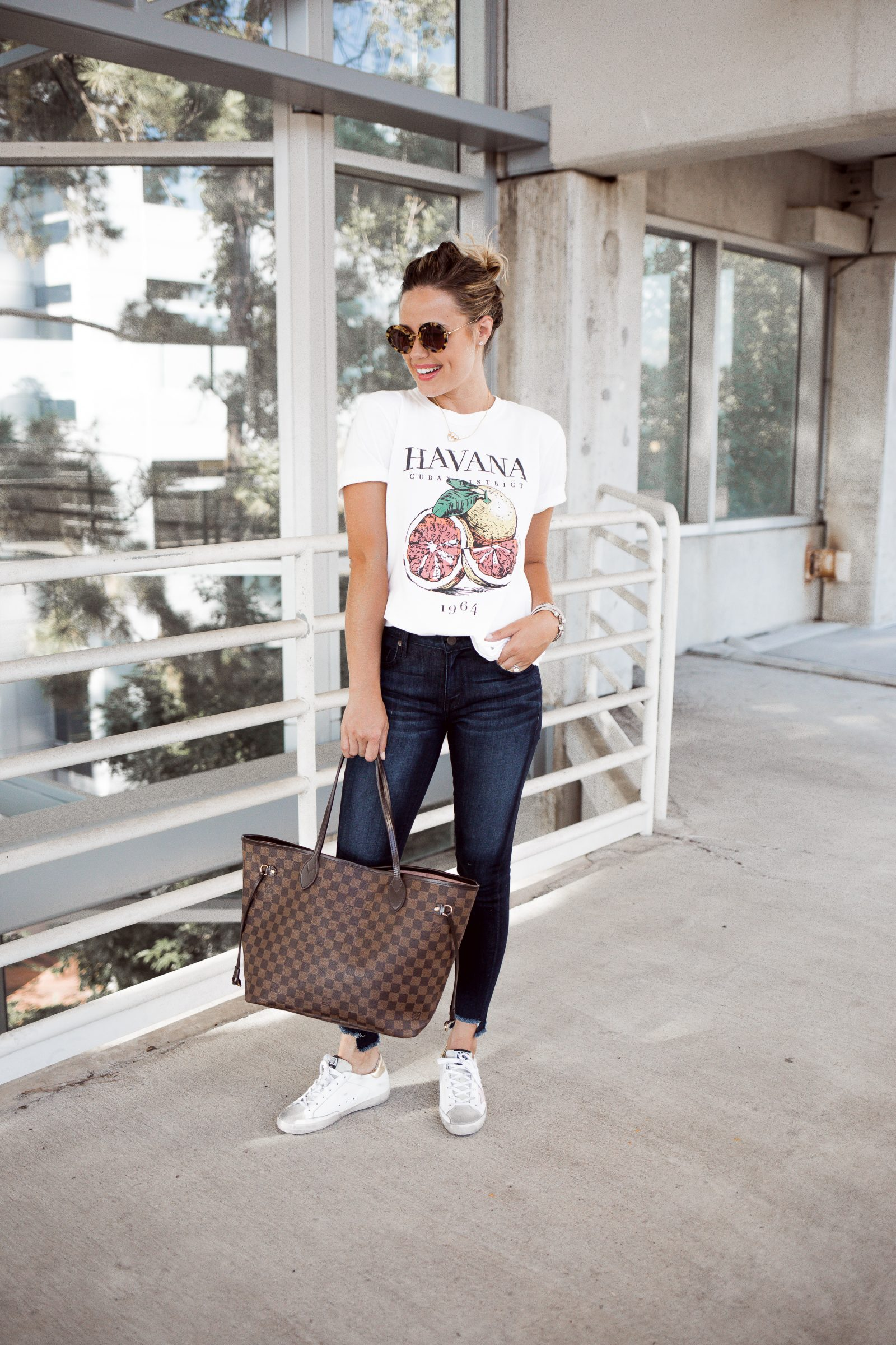 Houston fashion blogger Elly brown wears a graphic tee with denim for a casual look