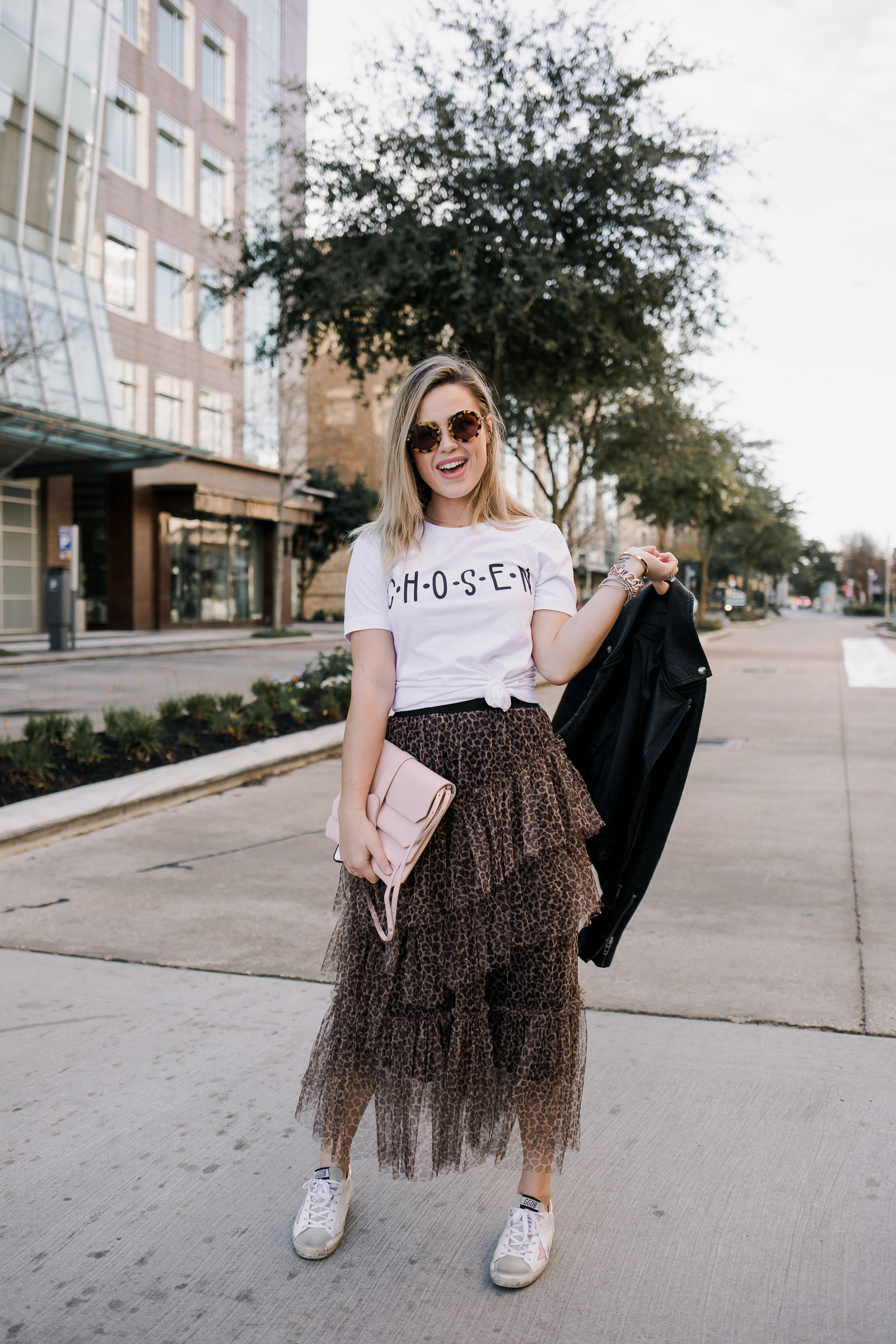 Houston fashion blogger Elly brown wears a ruffle midi skirt with a graphic tee