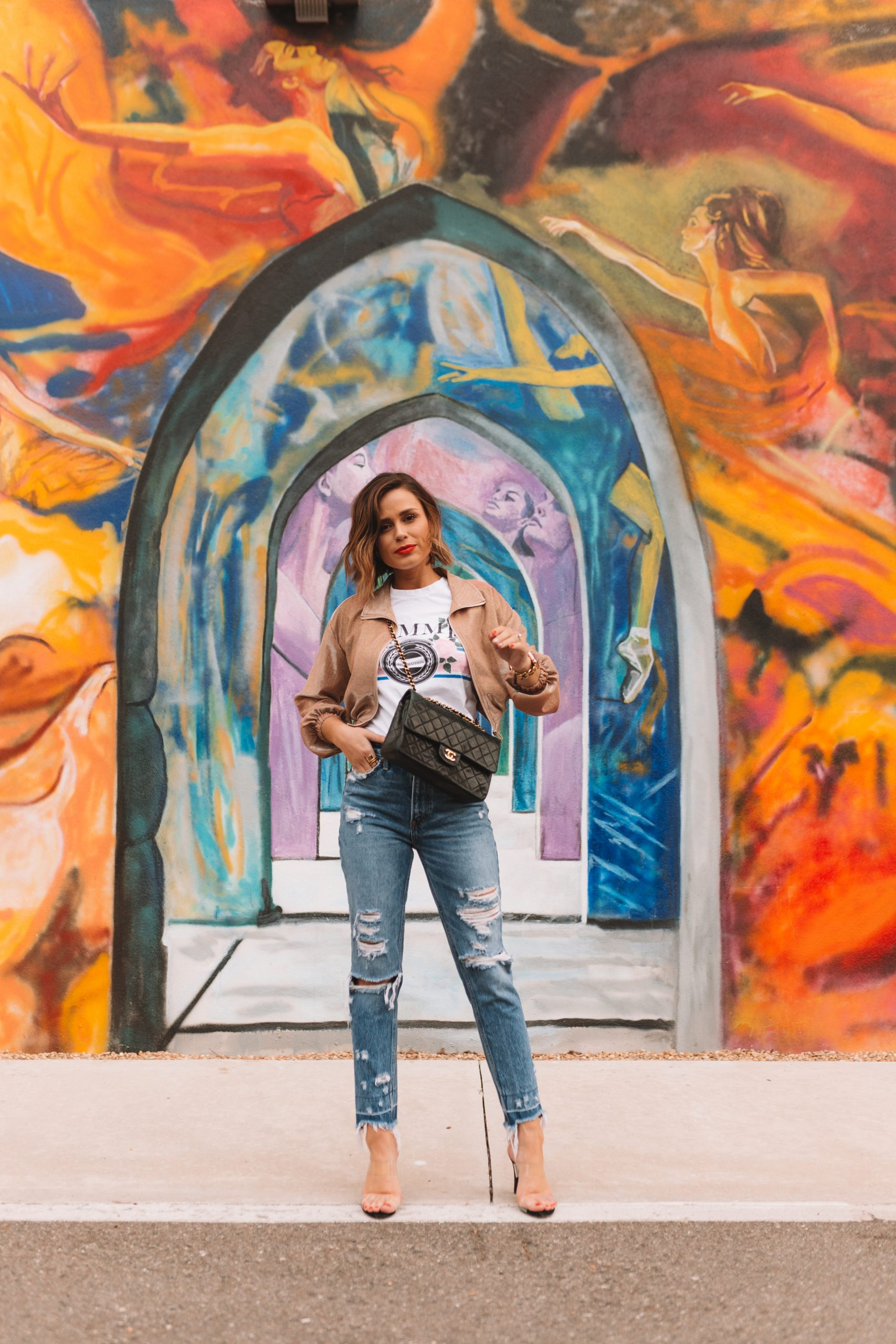 Houston fashion blogger Elly brown wears mom jeans with heels and a graphic tee for a casual look