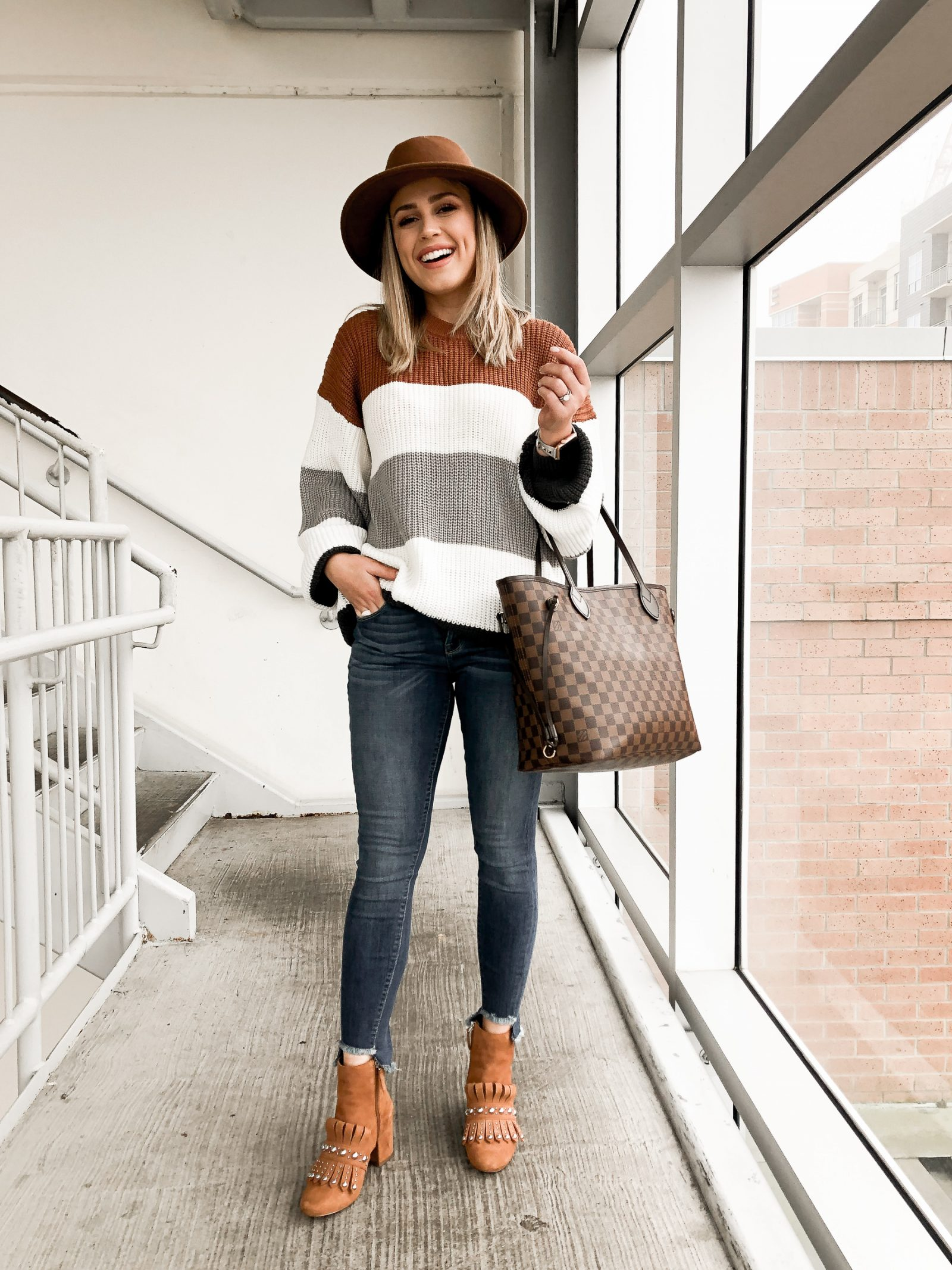 Houston blogger Uptown with Elly Brown wears a striped chunky sweater with the perfect Gucci booties dupe