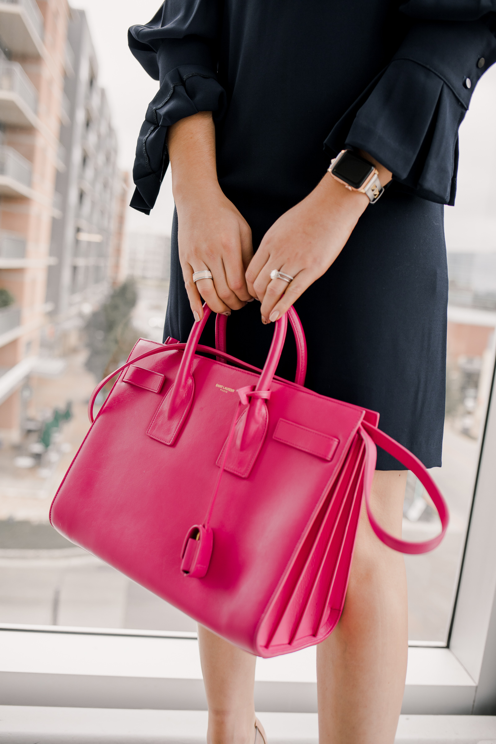 Houston fashion blogger Uptown with Elly Brown wears a pink YSL Sac De Jour bag