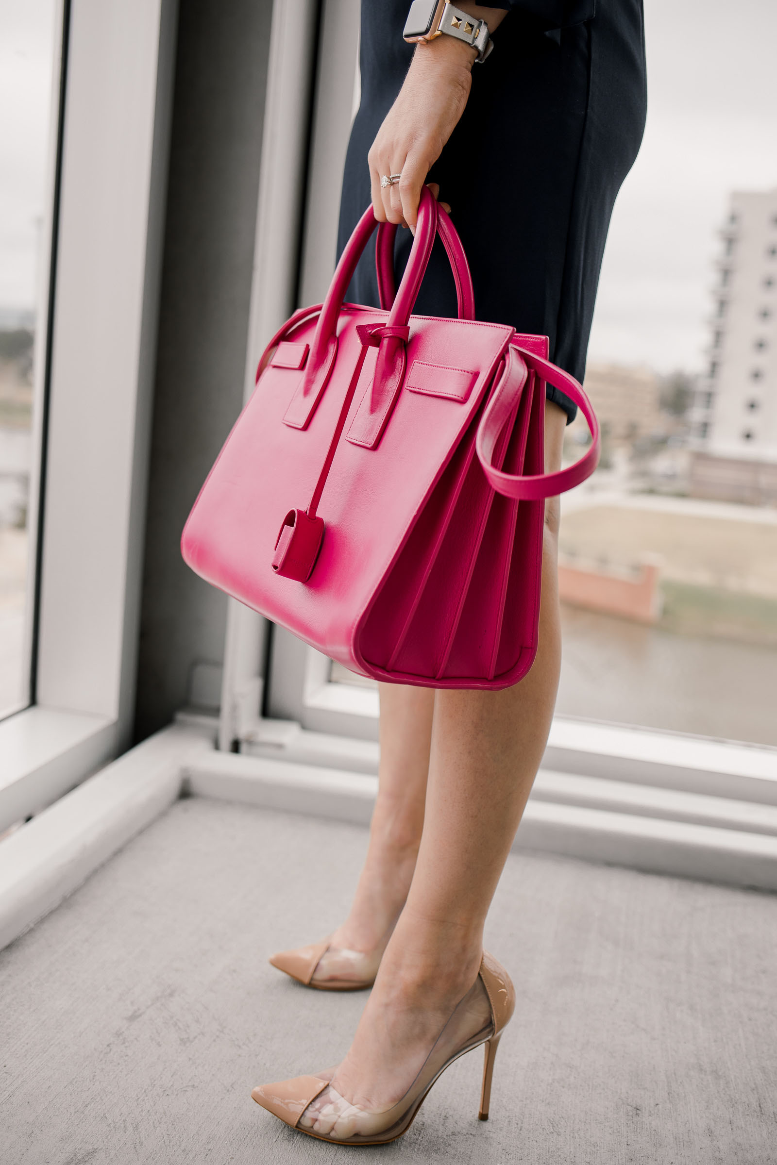 Houston fashion blogger Uptown with Elly Brown wears nude clear Schutz shoes with a YSL Sac De Jour bag