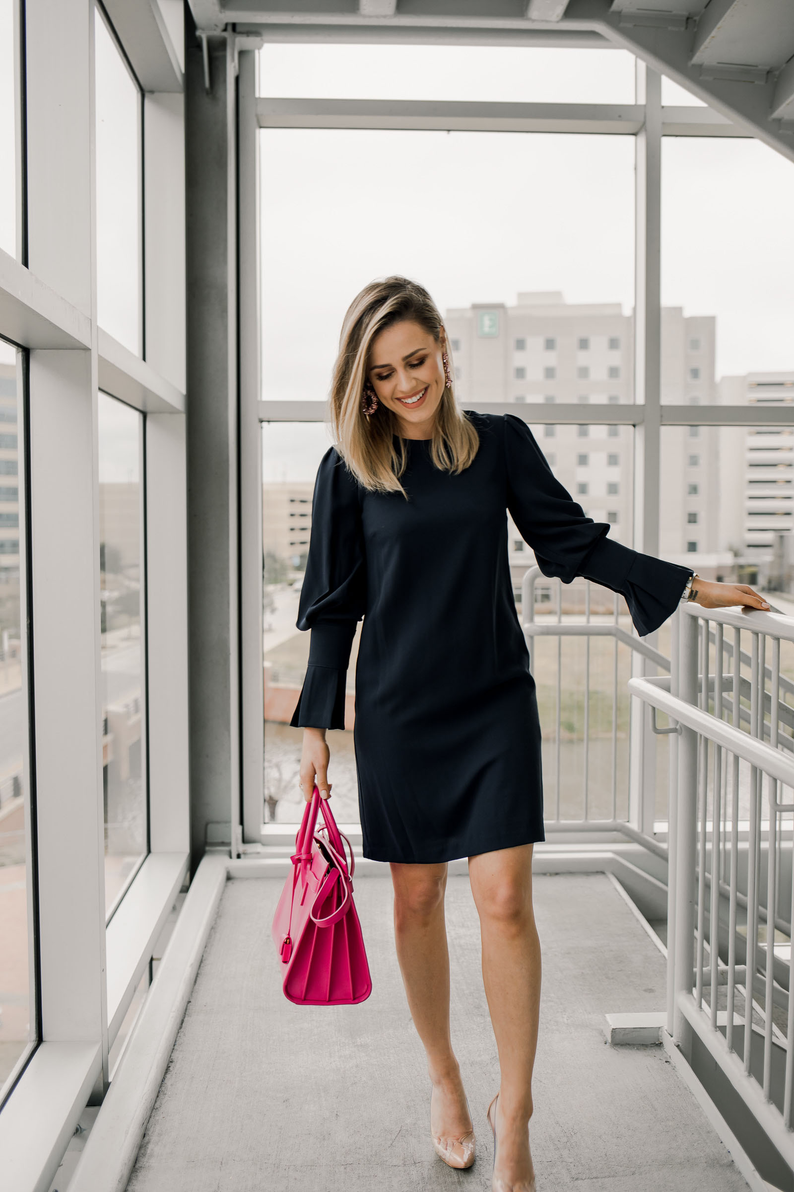Looking for ideas on what to wear to work for Valentine's Day? Houston fashion blogger Uptown with Elly Brown shares a chic outfit!