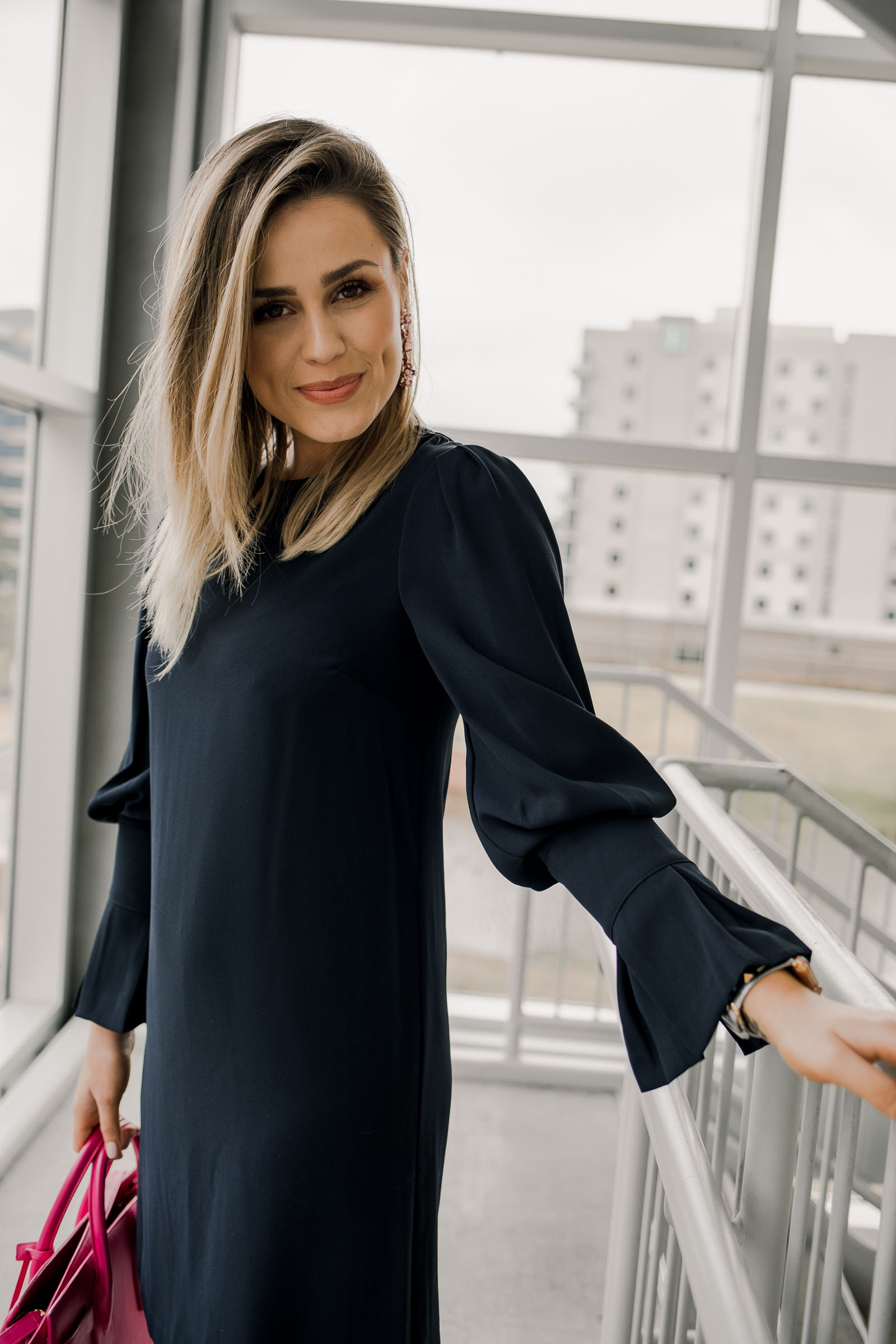 Houston fashion blogger Uptown with Elly Brown wears a navy blue shift dress