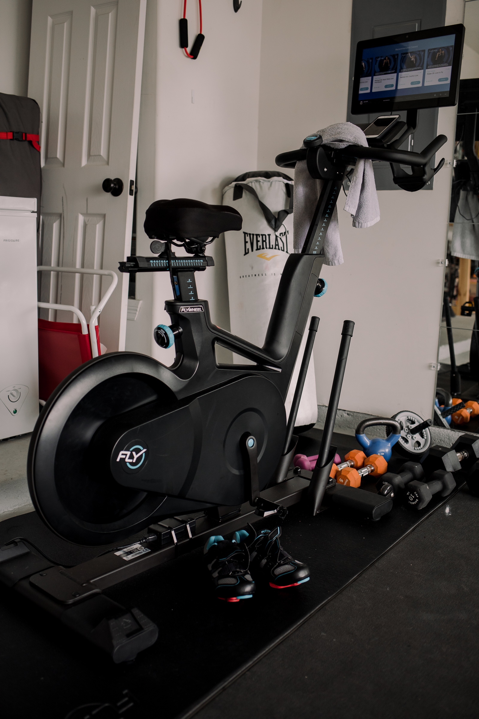 Houston lifestyle blogger Uptown with Elly Brown shares her Flywheel Sports Review and why she loves her at home bike.