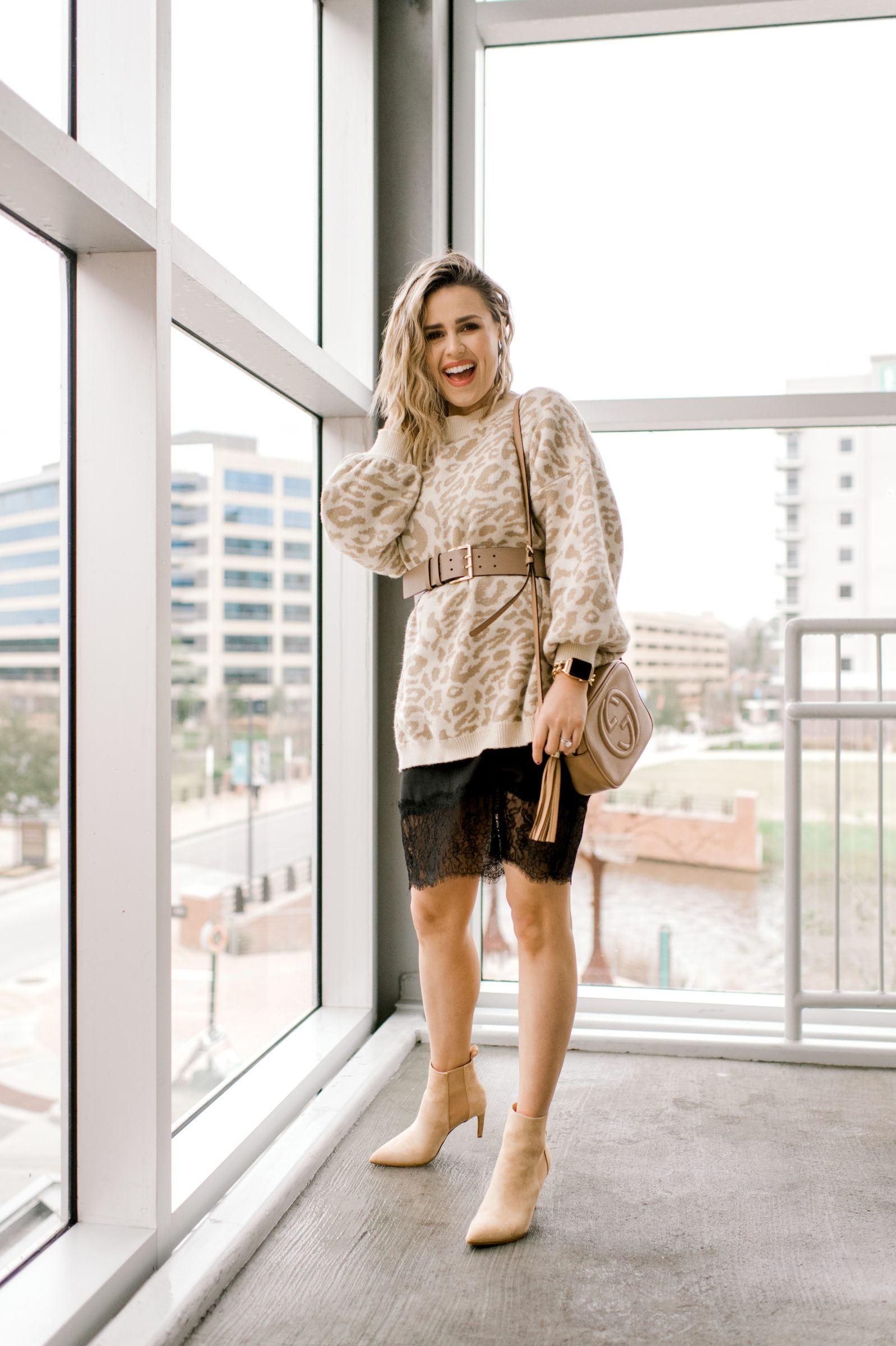 Houston fashion blogger Uptown with Elly Brown wears a layers her sweater over a slip dress for winter