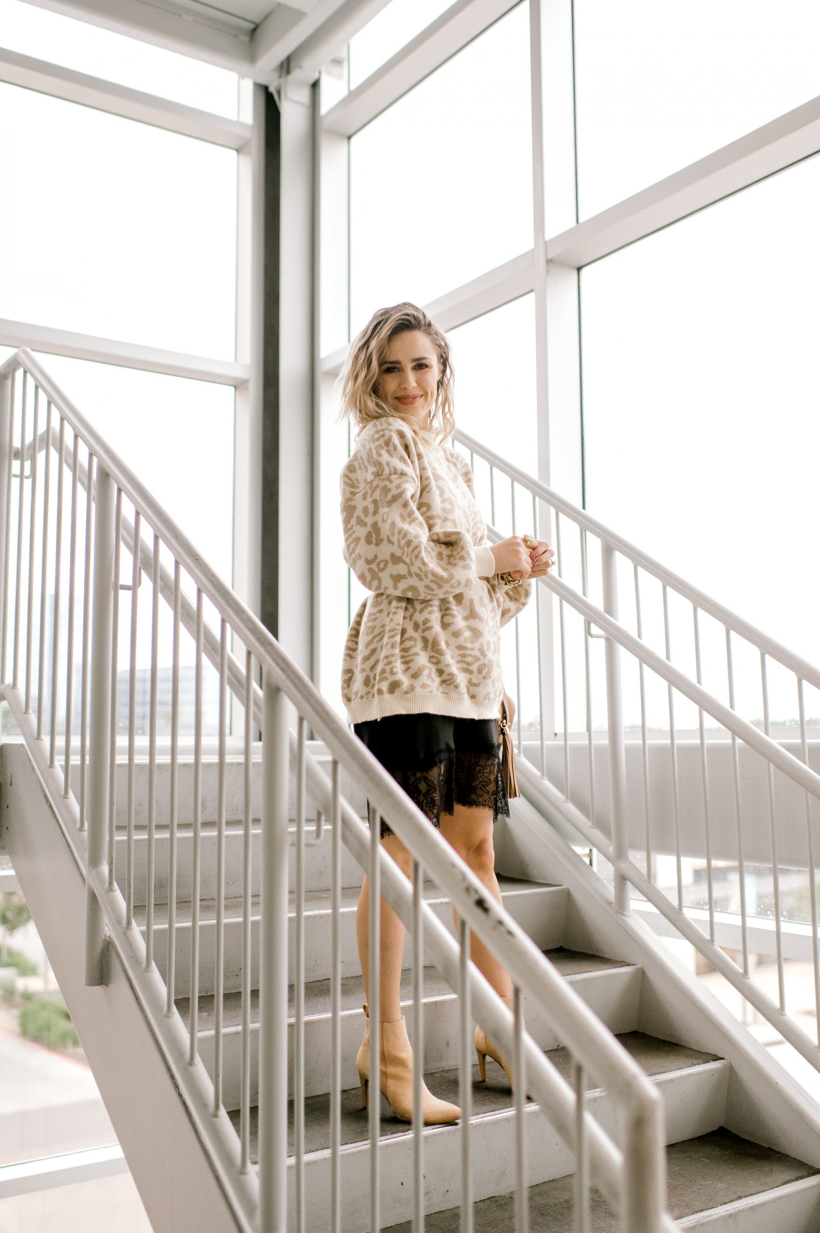 Houston fashion blogger Uptown with Elly Brown wears a nude 42 Gold Suede booties