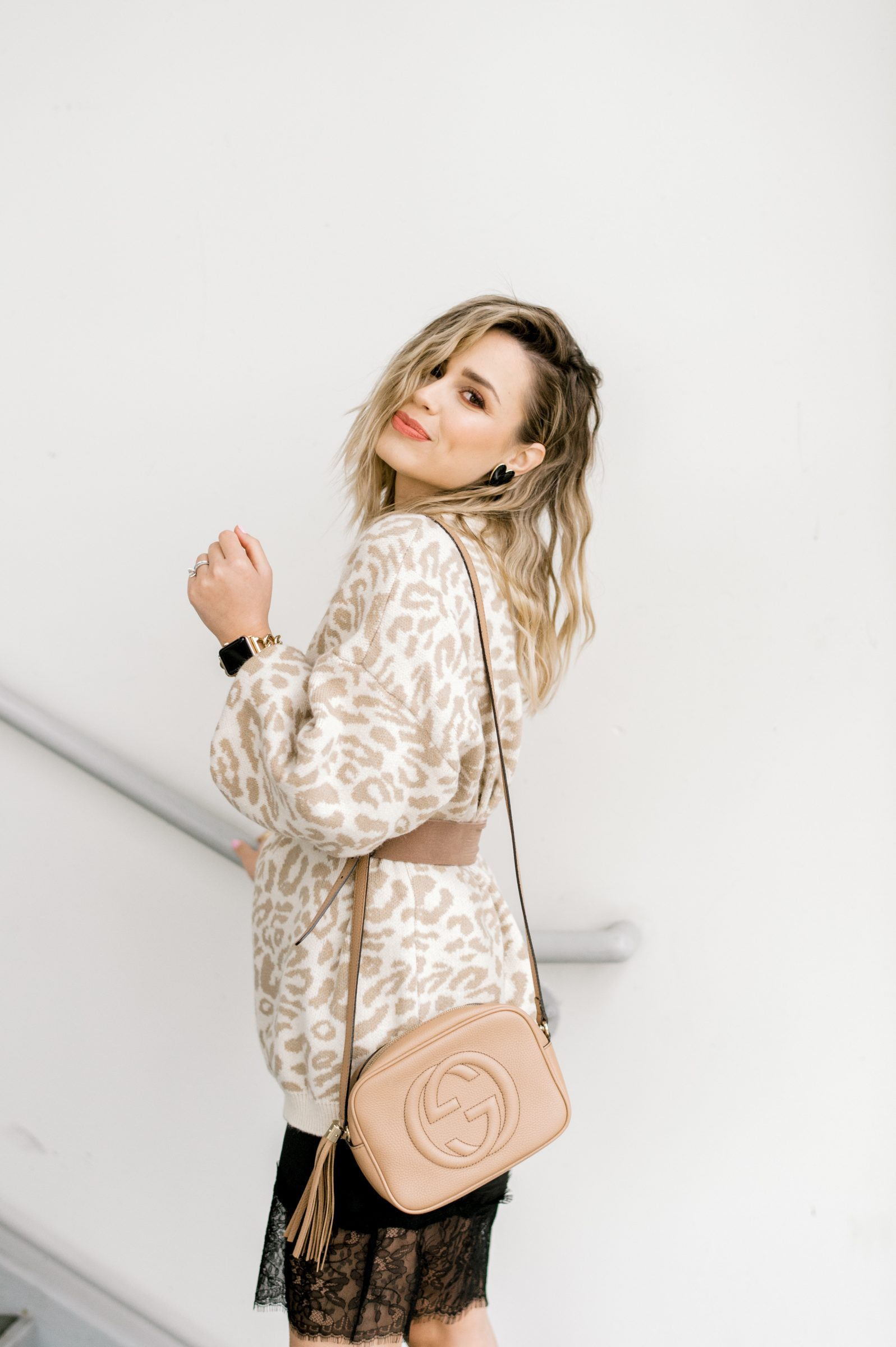 Houston fashion blogger Uptown with Elly Brown wears a leopard sweater and a Gucci Soho Disc crossbody bag