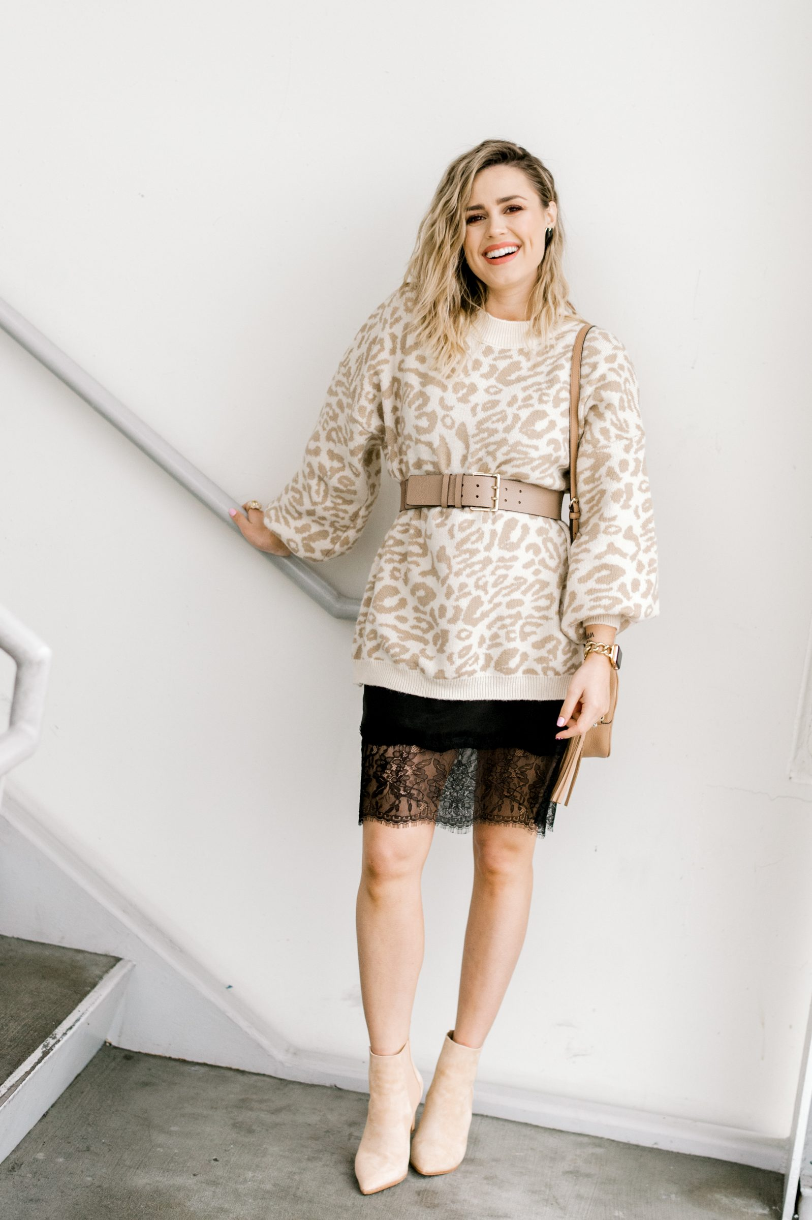 Houston fashion blogger Uptown with Elly Brown wears a leopard sweater belted with a slip dress